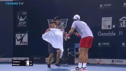 Fernando Verdasco shouts at the volunteer over a towel