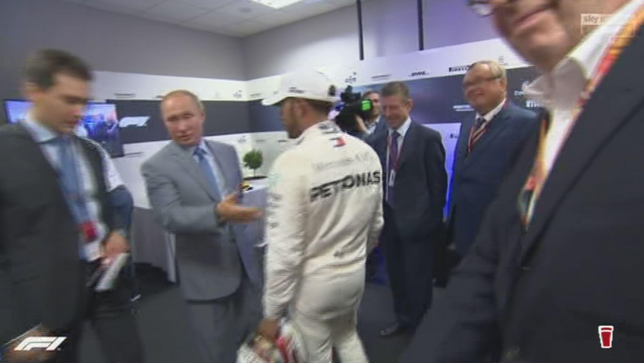 Vladimir Putin instructs his interpreter to warn Lewis Hamilton to forget any champagne antics