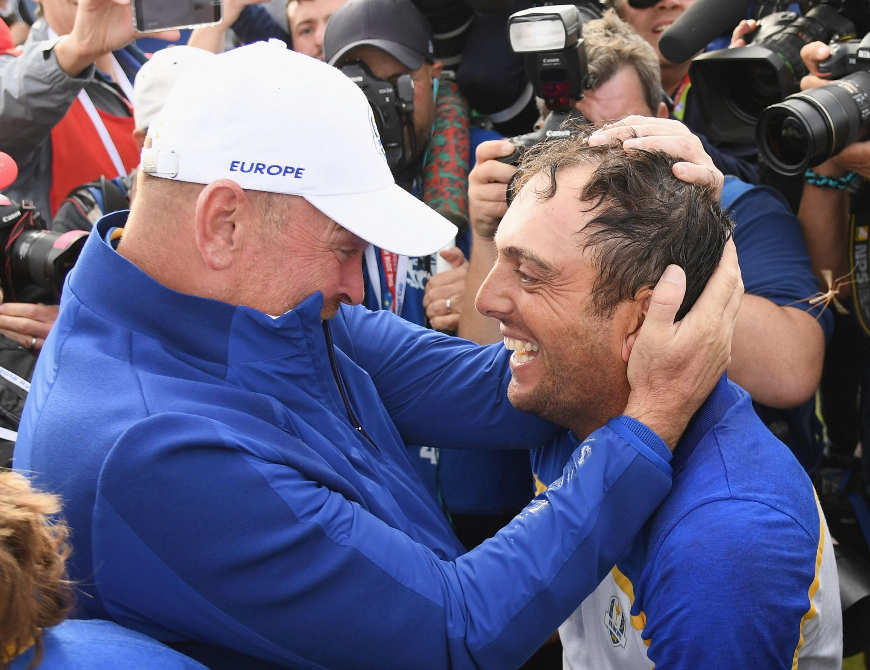 Francesco Molinari celebrates after beating Phil Mickelson to seal victory
