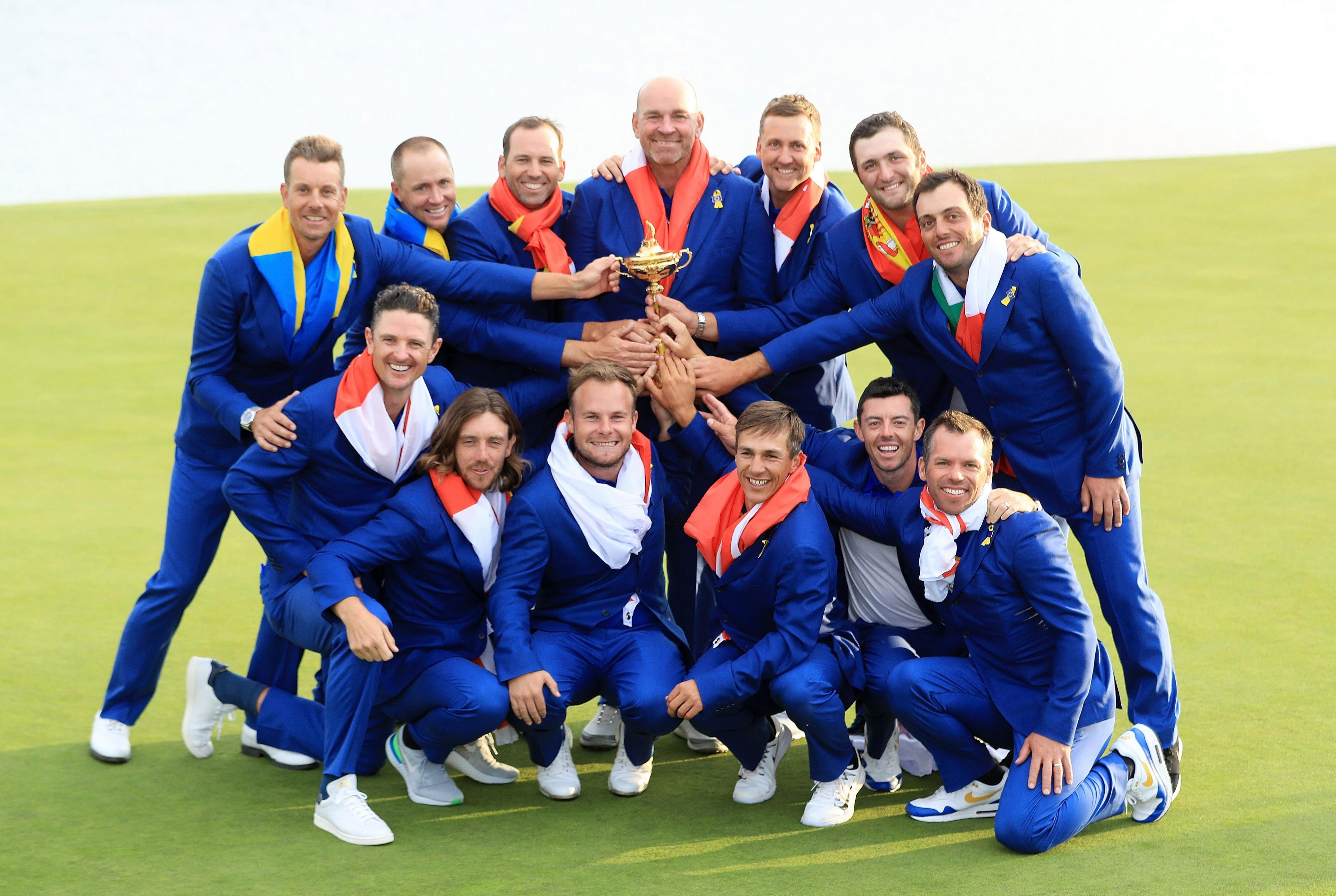 Europe celebrate with the Ryder Cup after beating USA