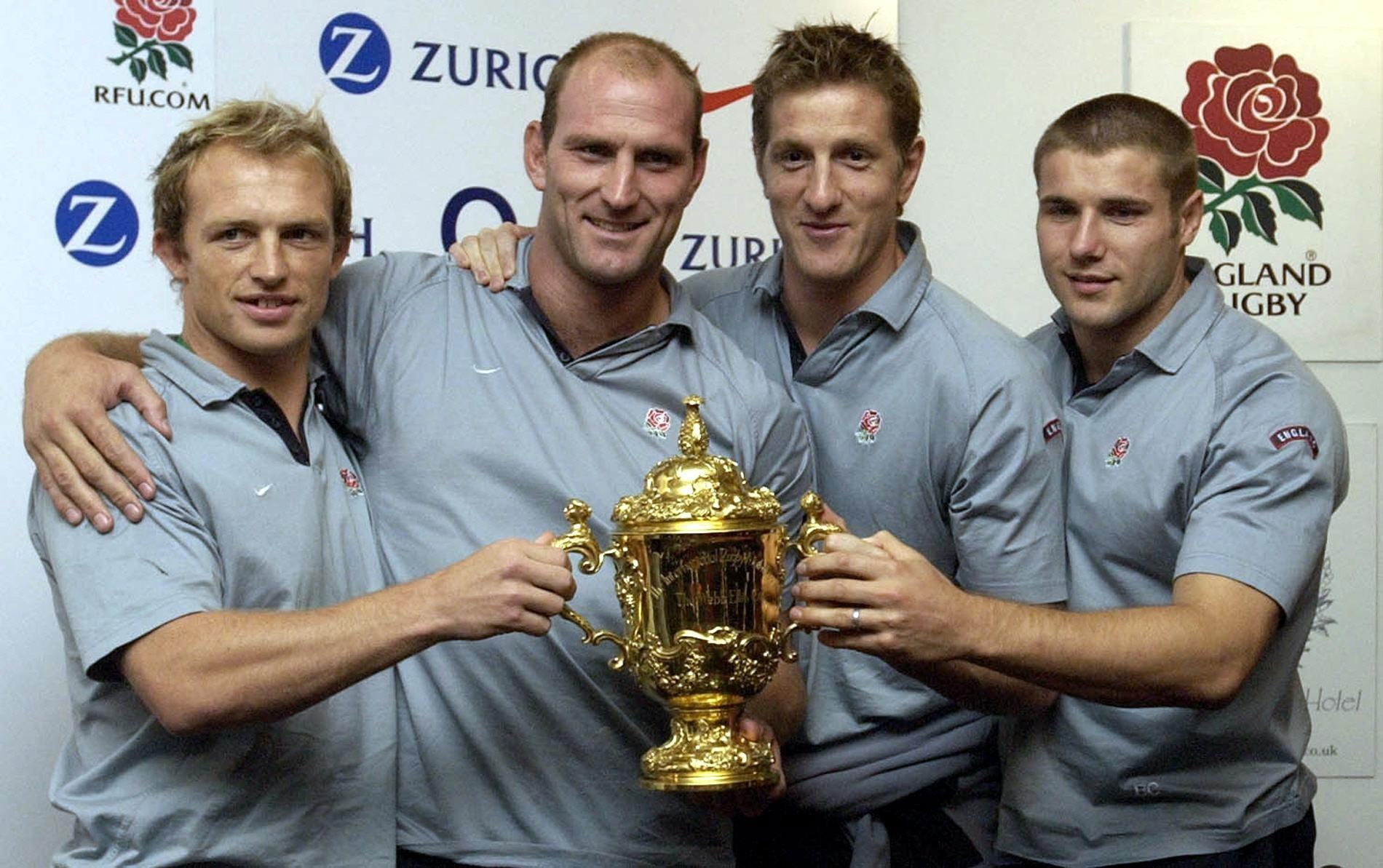 The pain seemed to be worth it after picking up the Web Ellis World Cup in 2003 (far right)