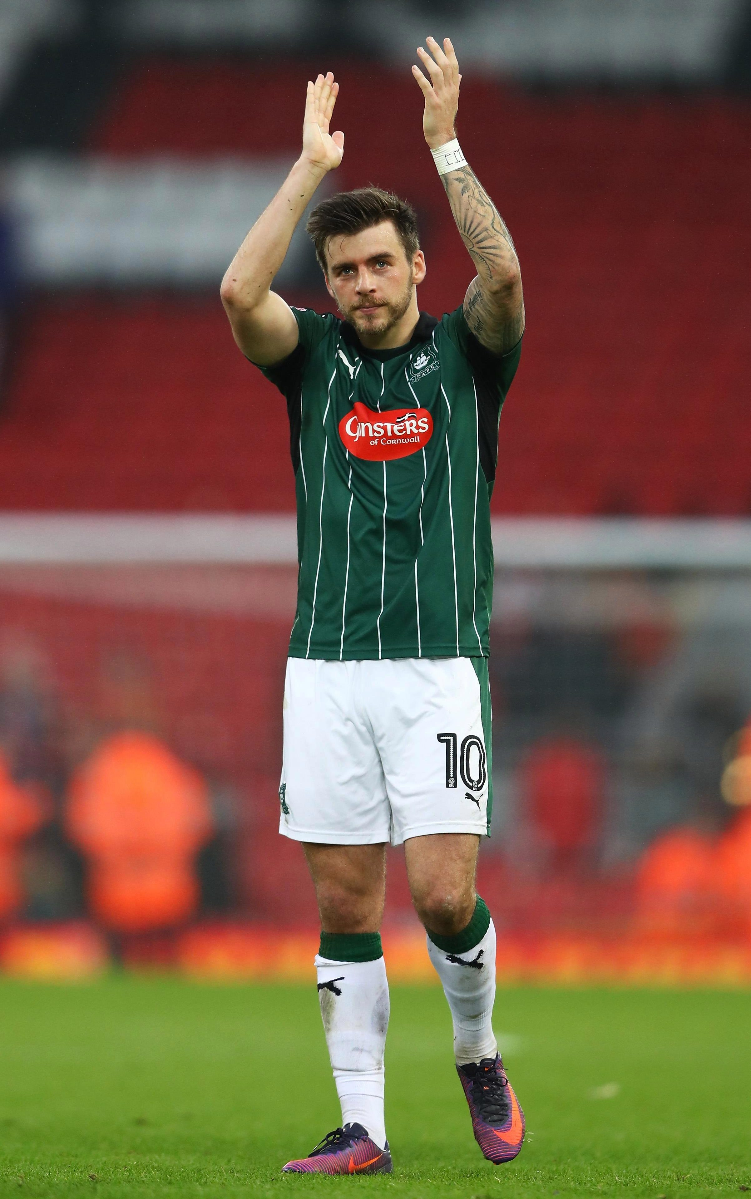 Argyle skipper Graham Carey applauds fans after a famous 0-0 draw at Liverpool