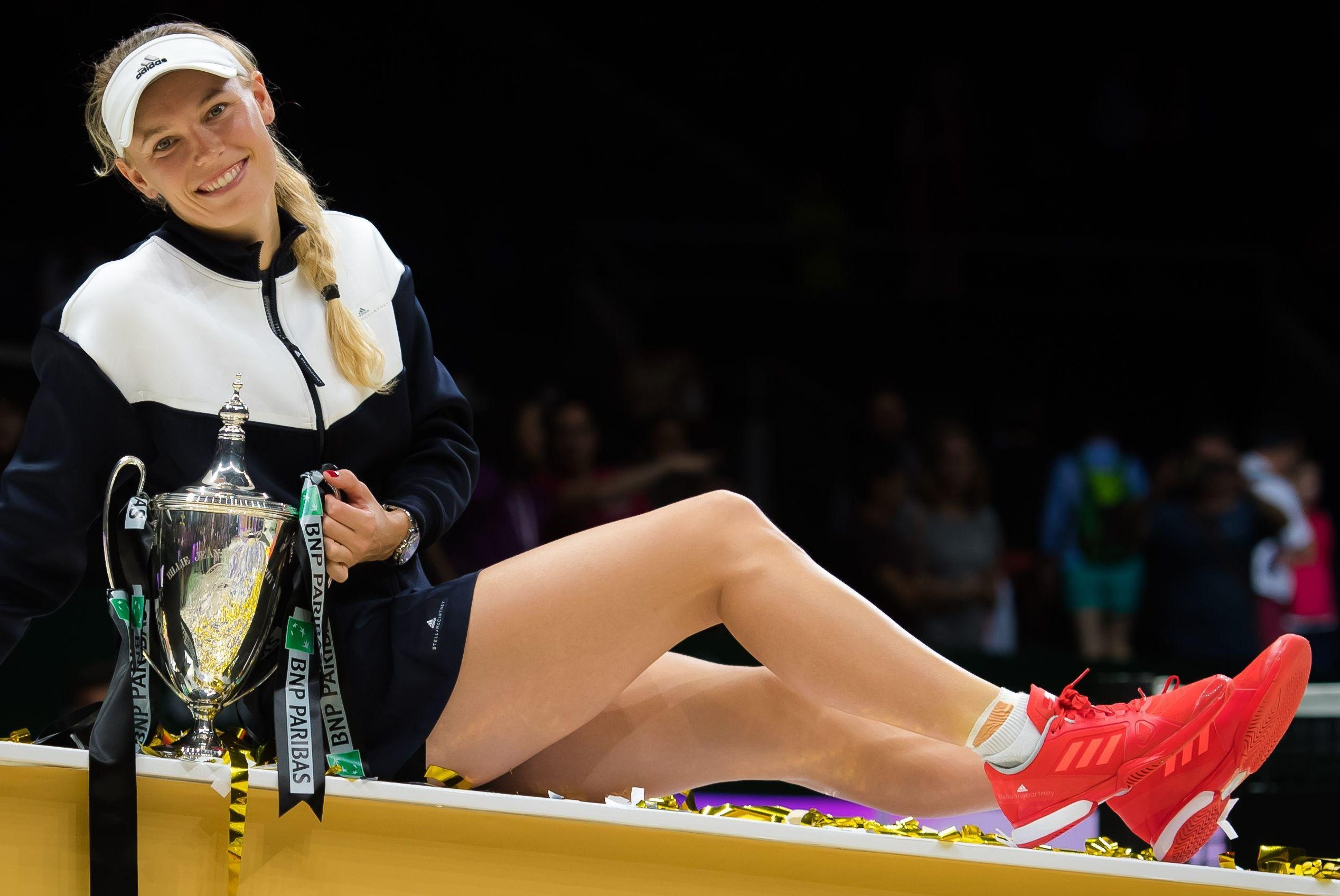 Caroline Wozniacki relaxes with the trophy after her 2107 WTA Finals triumph