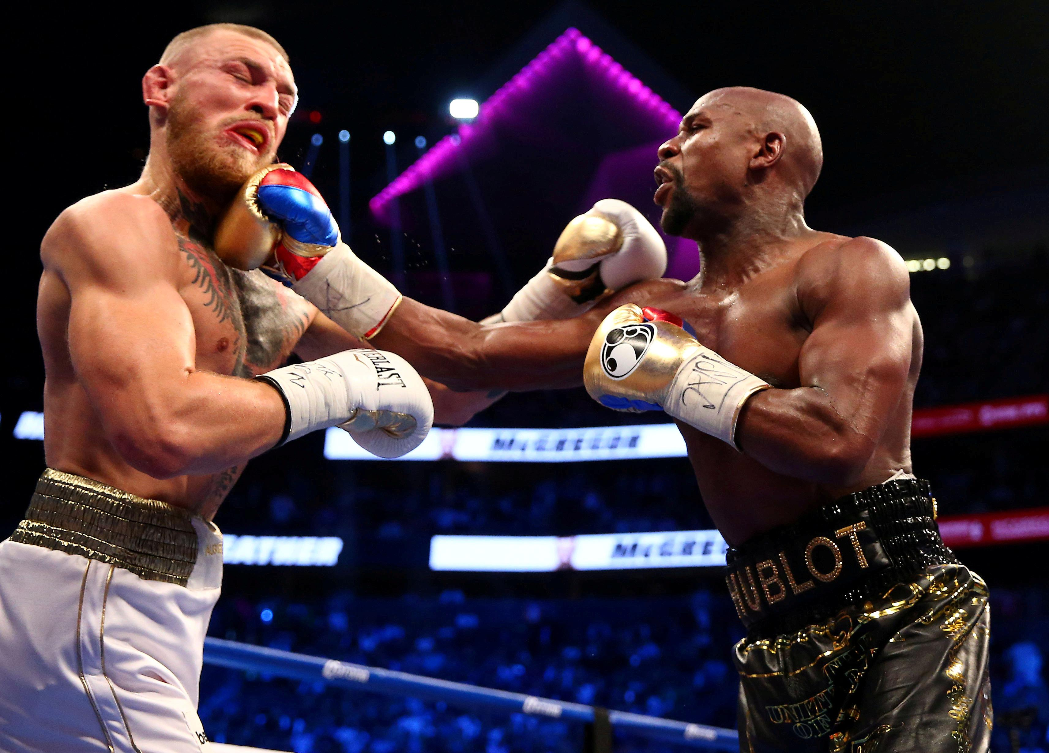 UFC star Conor McGregor switched combats to fight Floyd Mayweather in a boxing ring last year