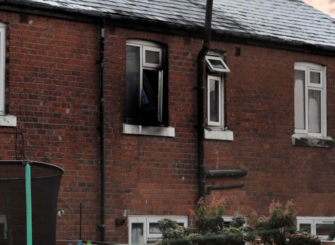 Two petrol bombs were thrown through a window into the family's home in Walkden, Greater Manchester