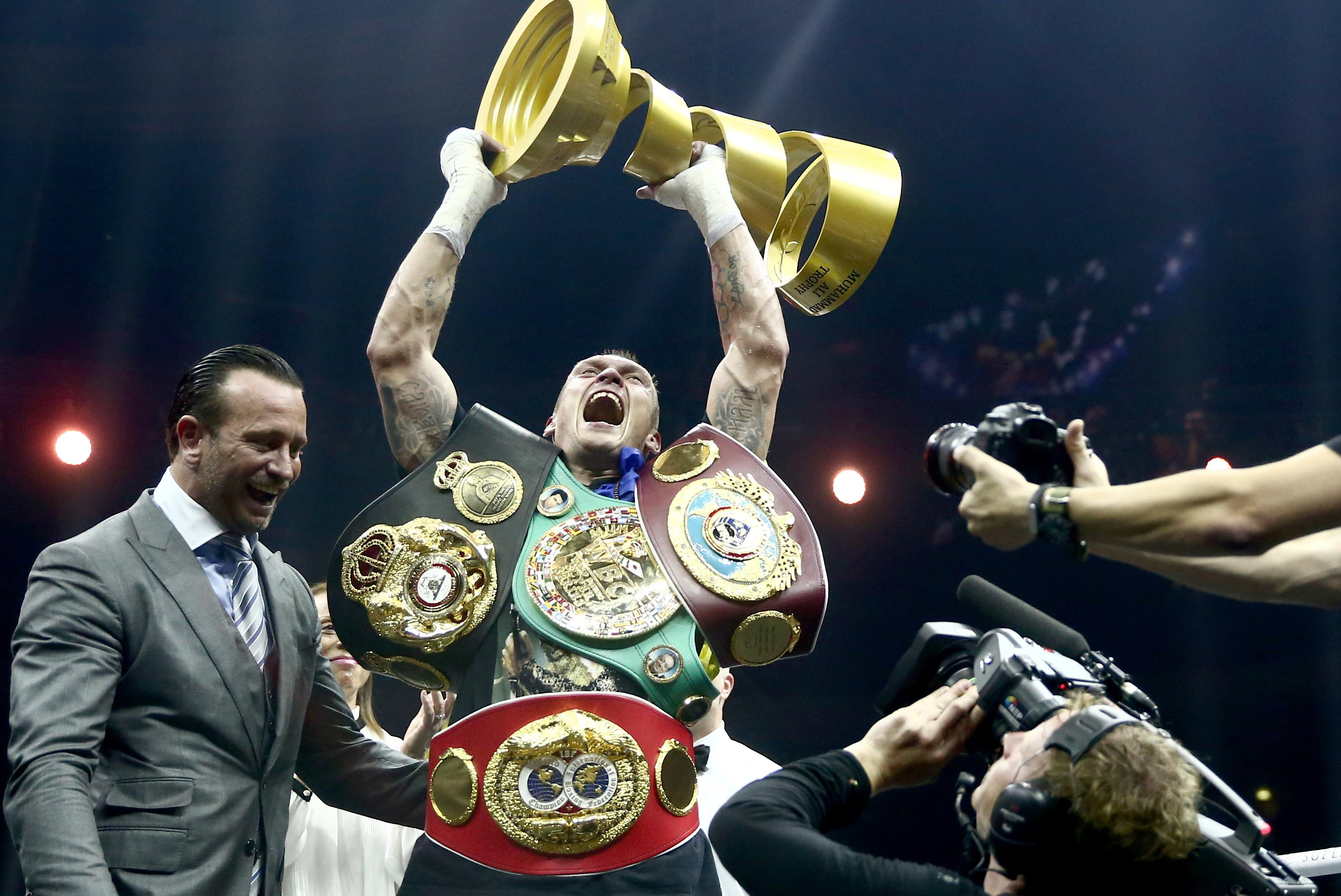 Usyk celebrates after beating Murat Gassiev to become the undisputed king back in July