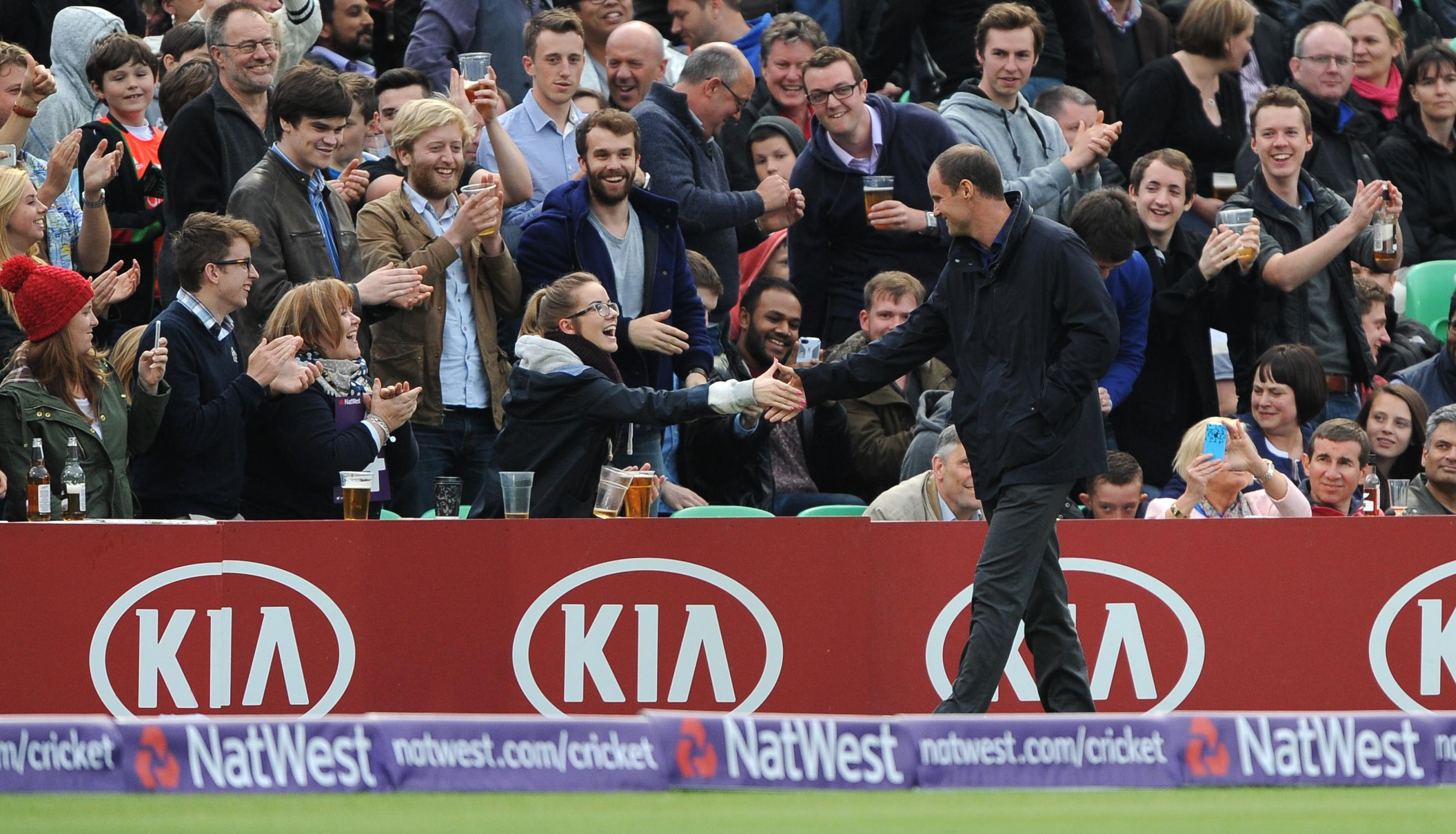 Andrew Strauss shakes the hands of fans at the Oval during Middlesex's match with Surrey
