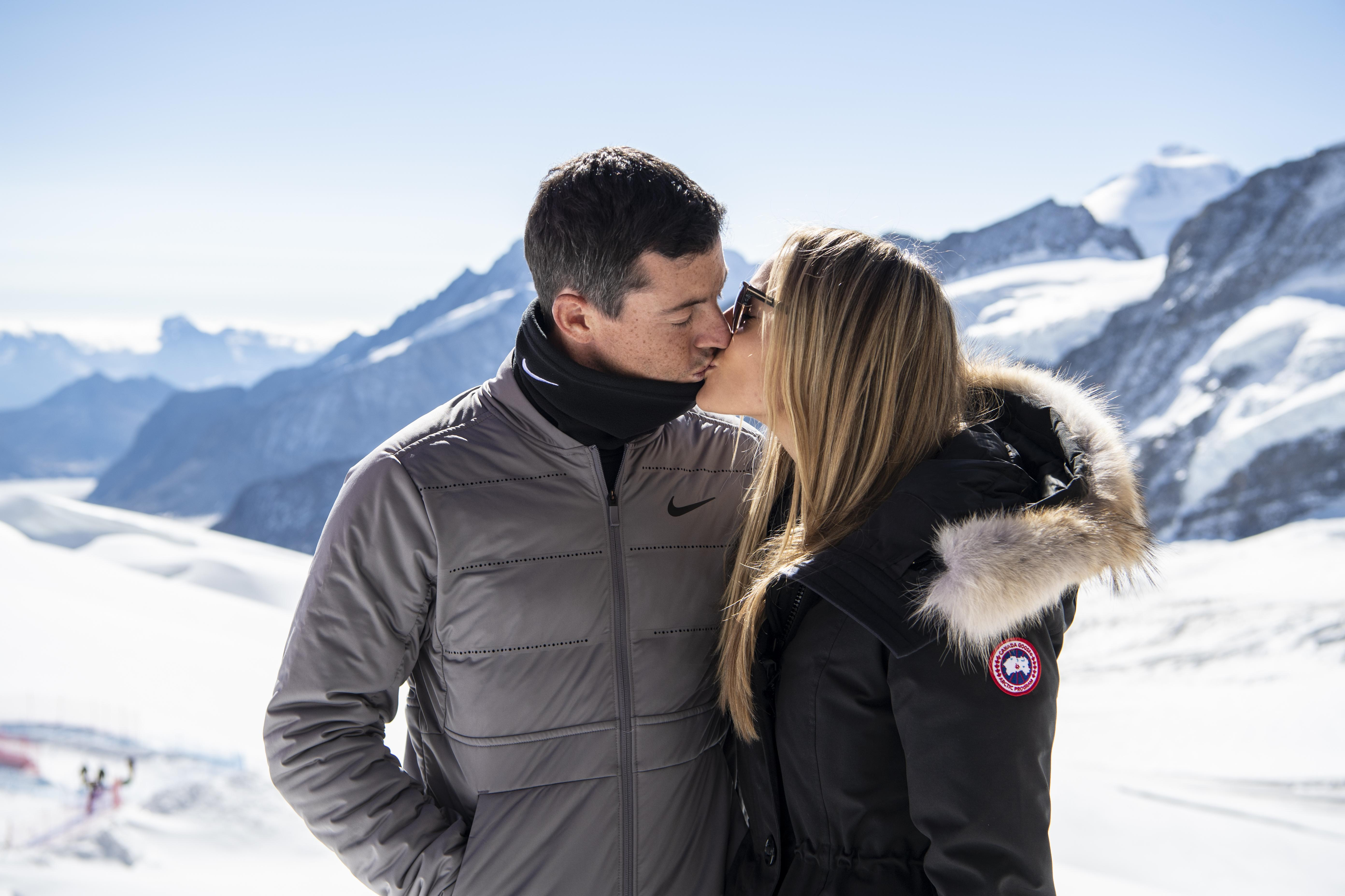 Rory McIlroy kisses his wife in the Swiss Alps