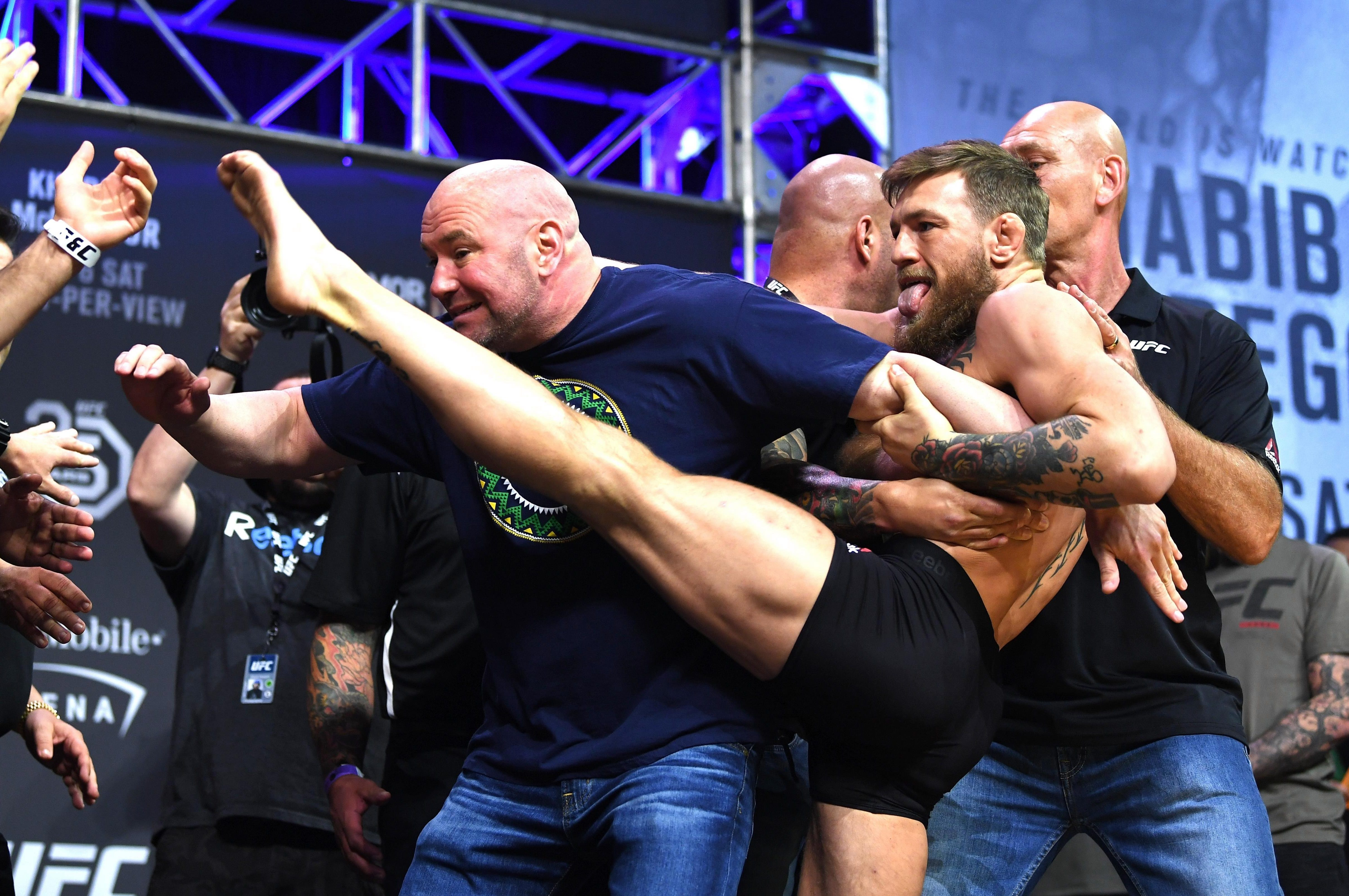 Conor McGregor of Ireland kicks towards Khabib Nurmagomedov of Russia as they face off during the UFC 229 weigh-in