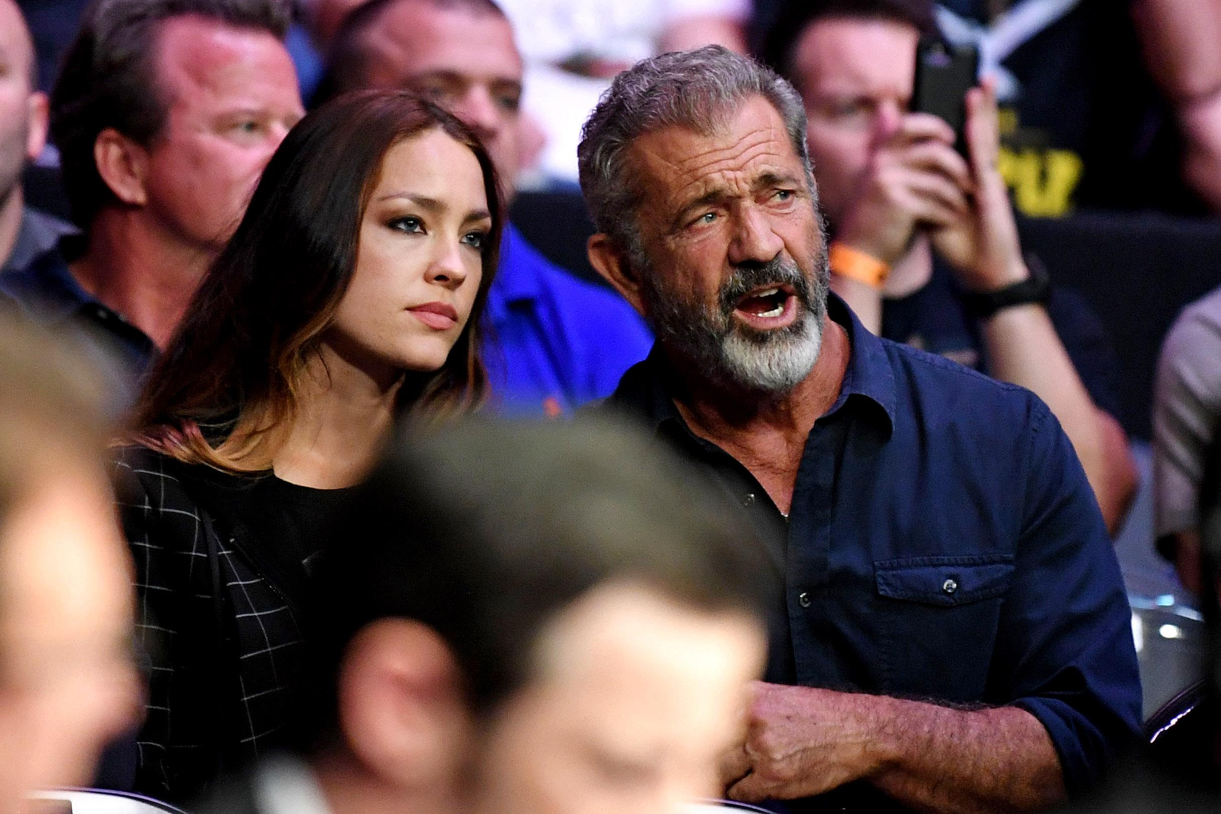 Mel Gibson, right, and long-term girlfriend Rosalind Ross were also ringside for the action-packed Conor McGregor fight