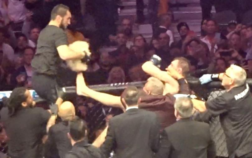 Another man sat on the octagon and tried to hit McGregor from above with a wig in hand