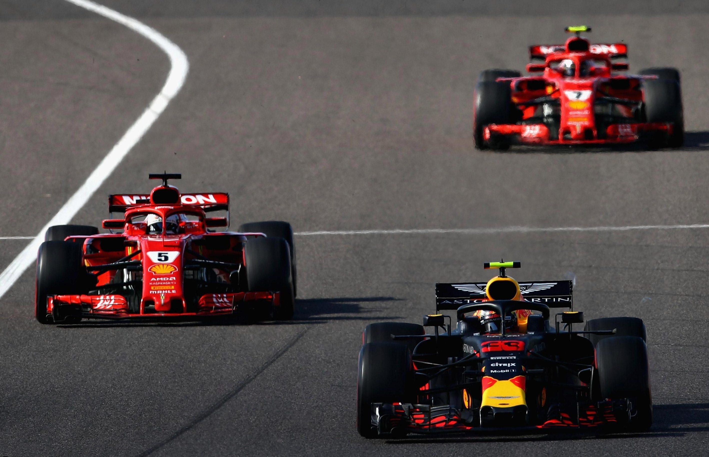 Red Bull's Max Verstappen, front, was hit by Sebastian Vettel, following, in Japan