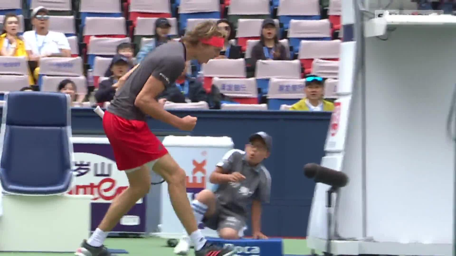 The ballboy was seen falling back in shock at the German tennis star's outburst of emotion