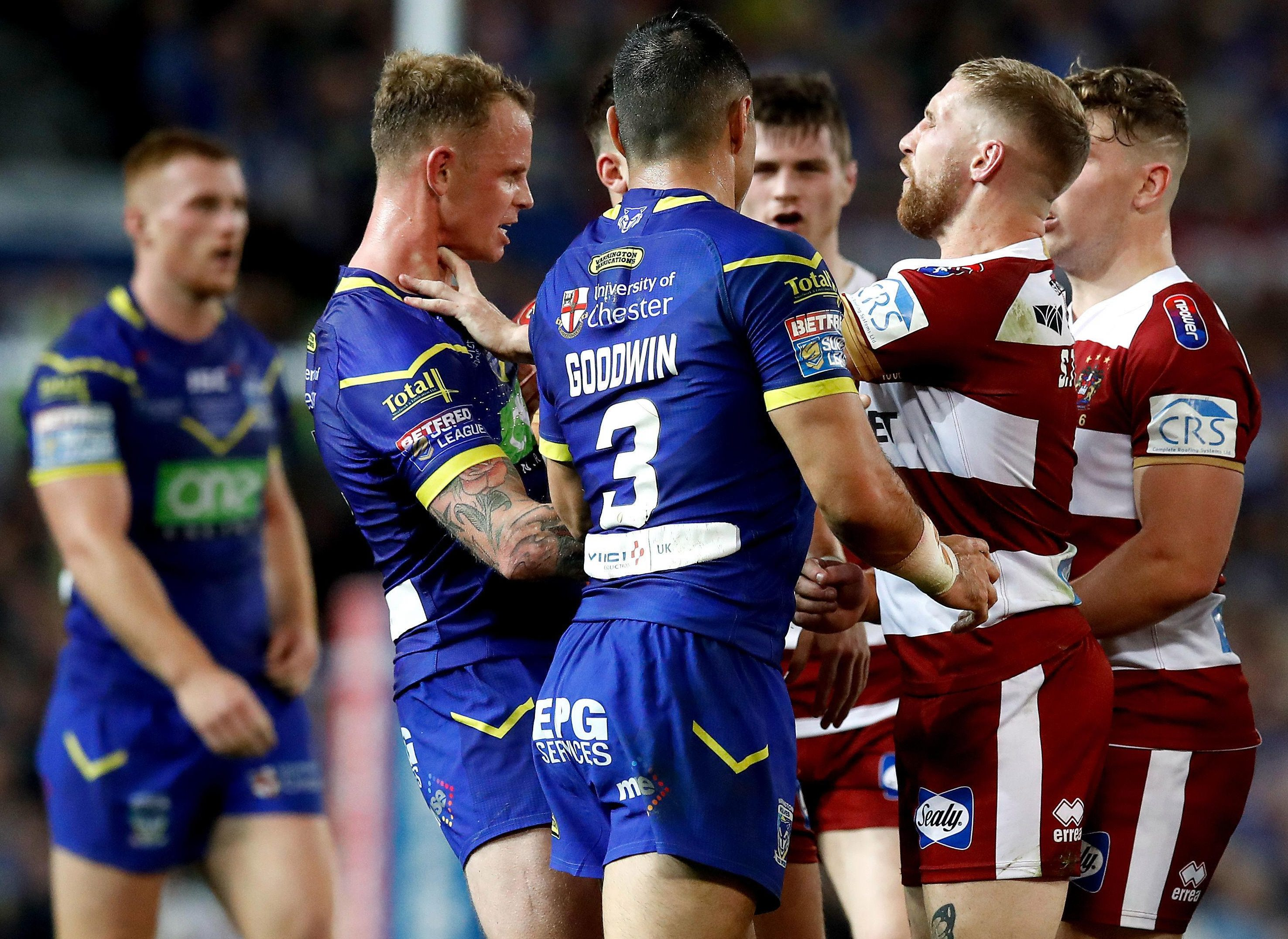 Warrington Wolves' Kevin Brown, left, and Wigan Warriors' Sam Tomkins, right, are caught in a flare-up