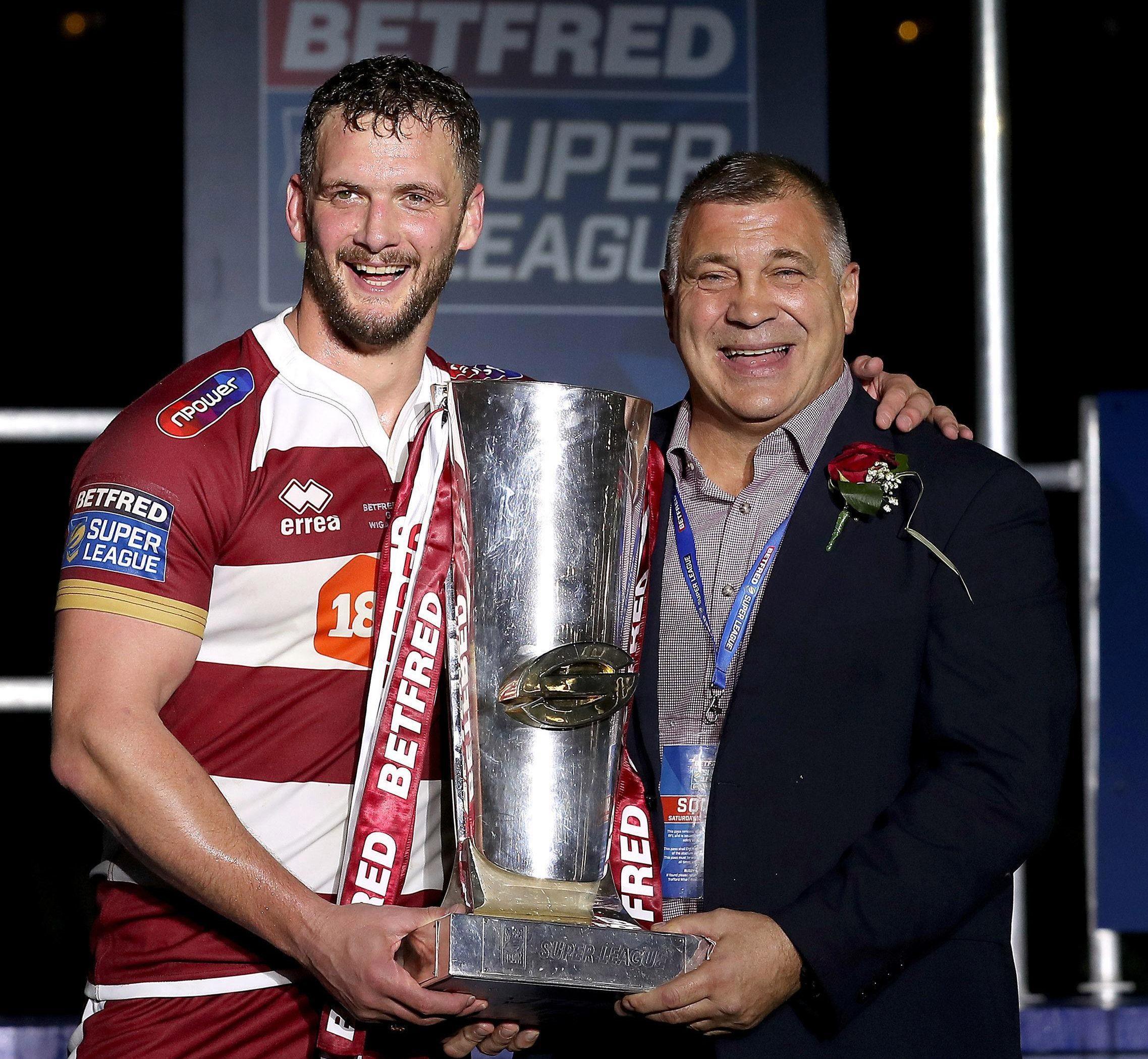 Wigan skipper Sean O'Loughlin, left, lifted the Super League trophy this year