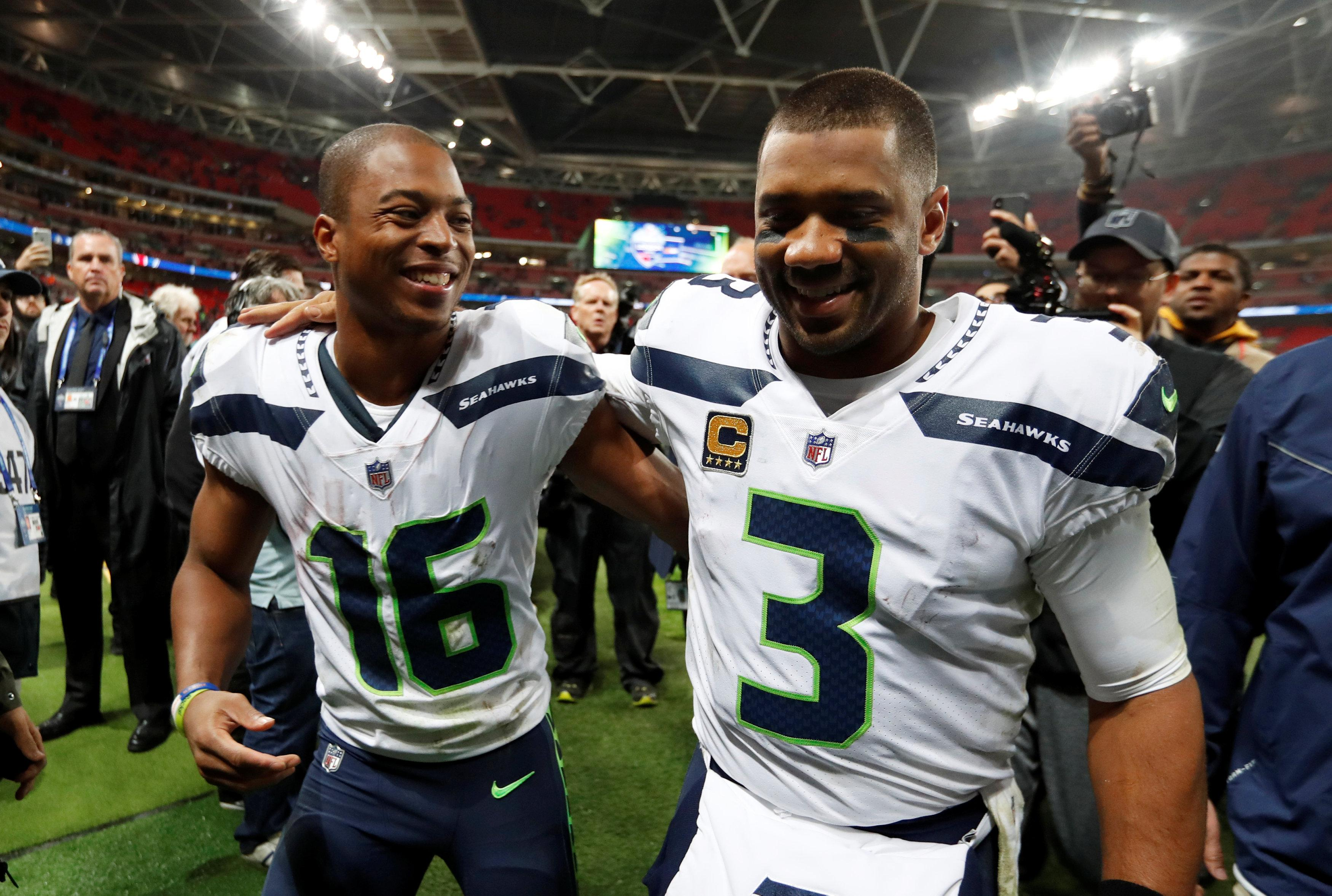 Tyler Lockett and Wilson celebrate pummelling the Oakland side