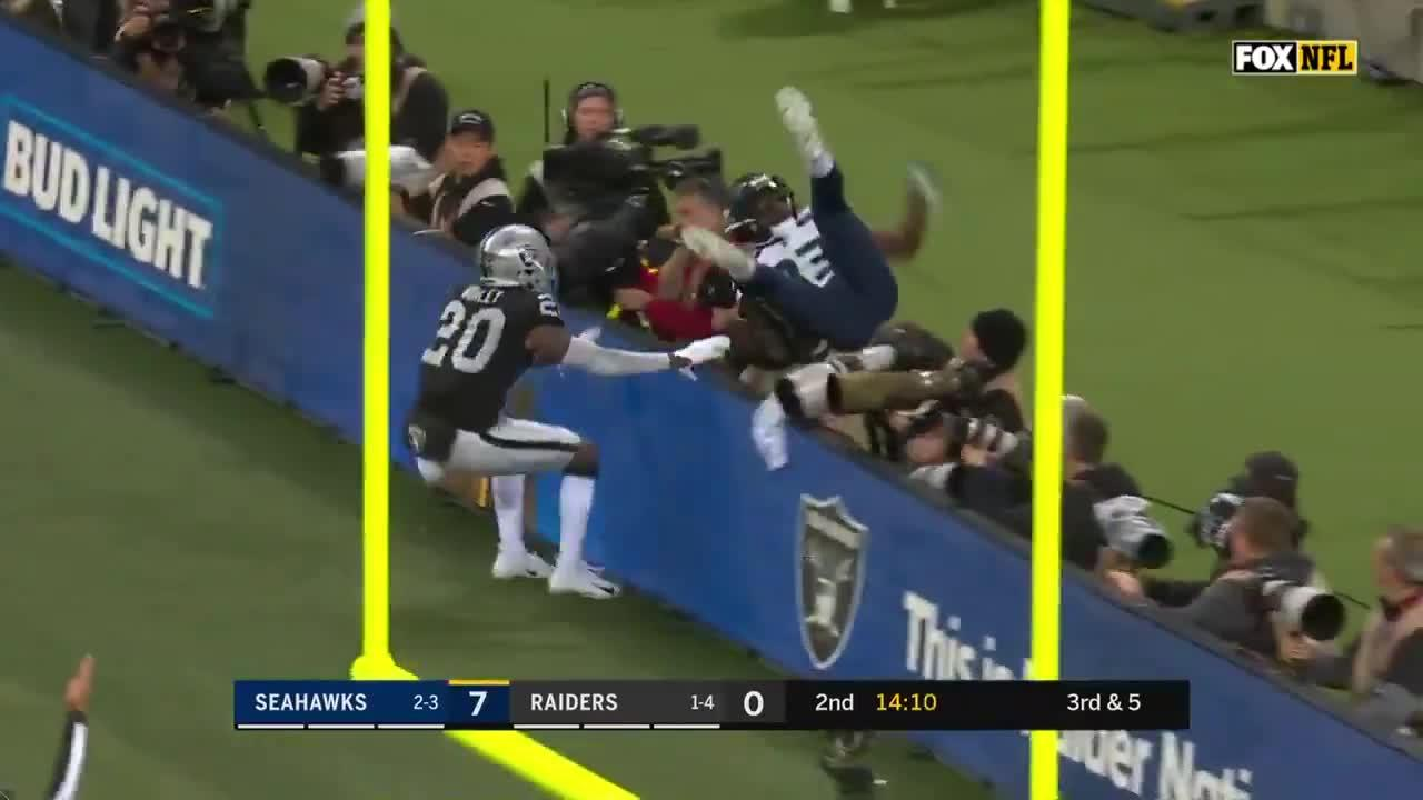 David Moore went flying into photographers after scoring his touchdown