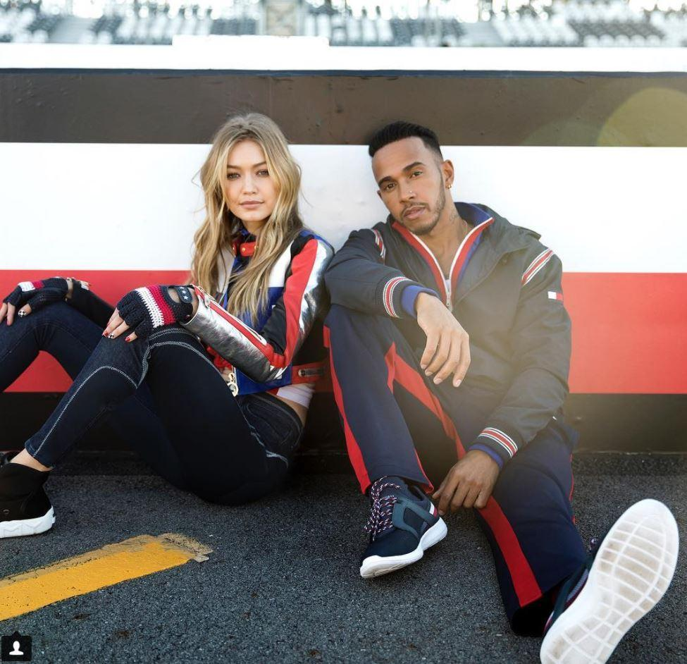Lewis Hamilton with Gigi Hadid as part of his promotion for his range with Tommy Hilfiger