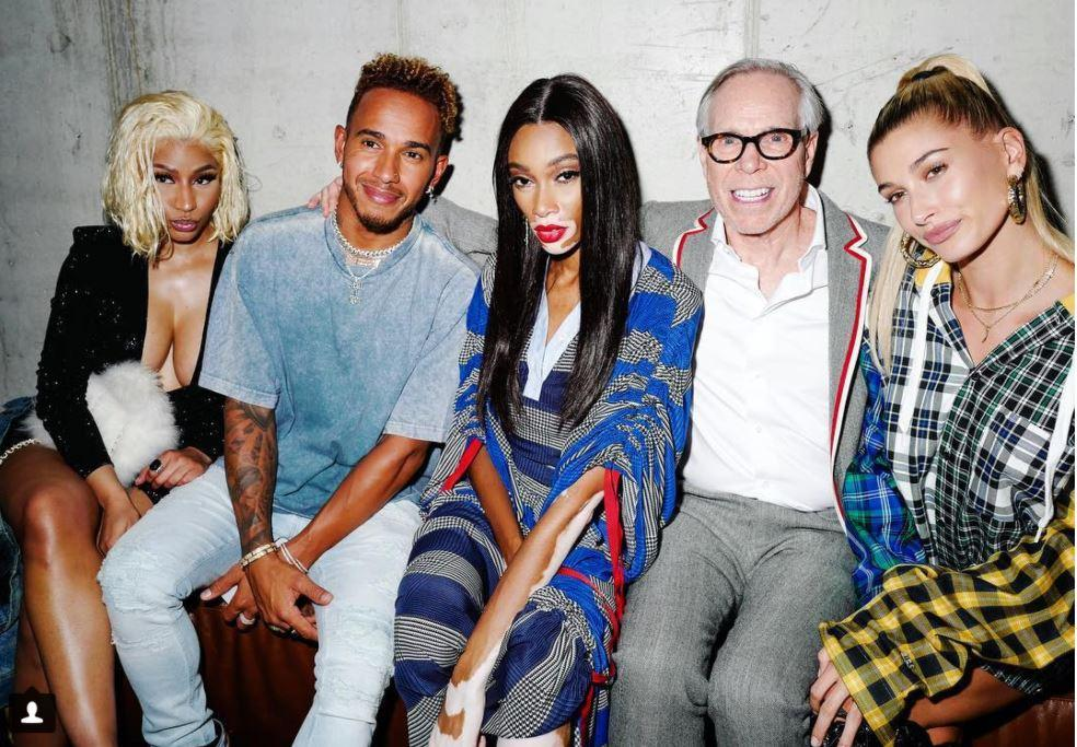 Hamilton regularly finds himself surrounded by models