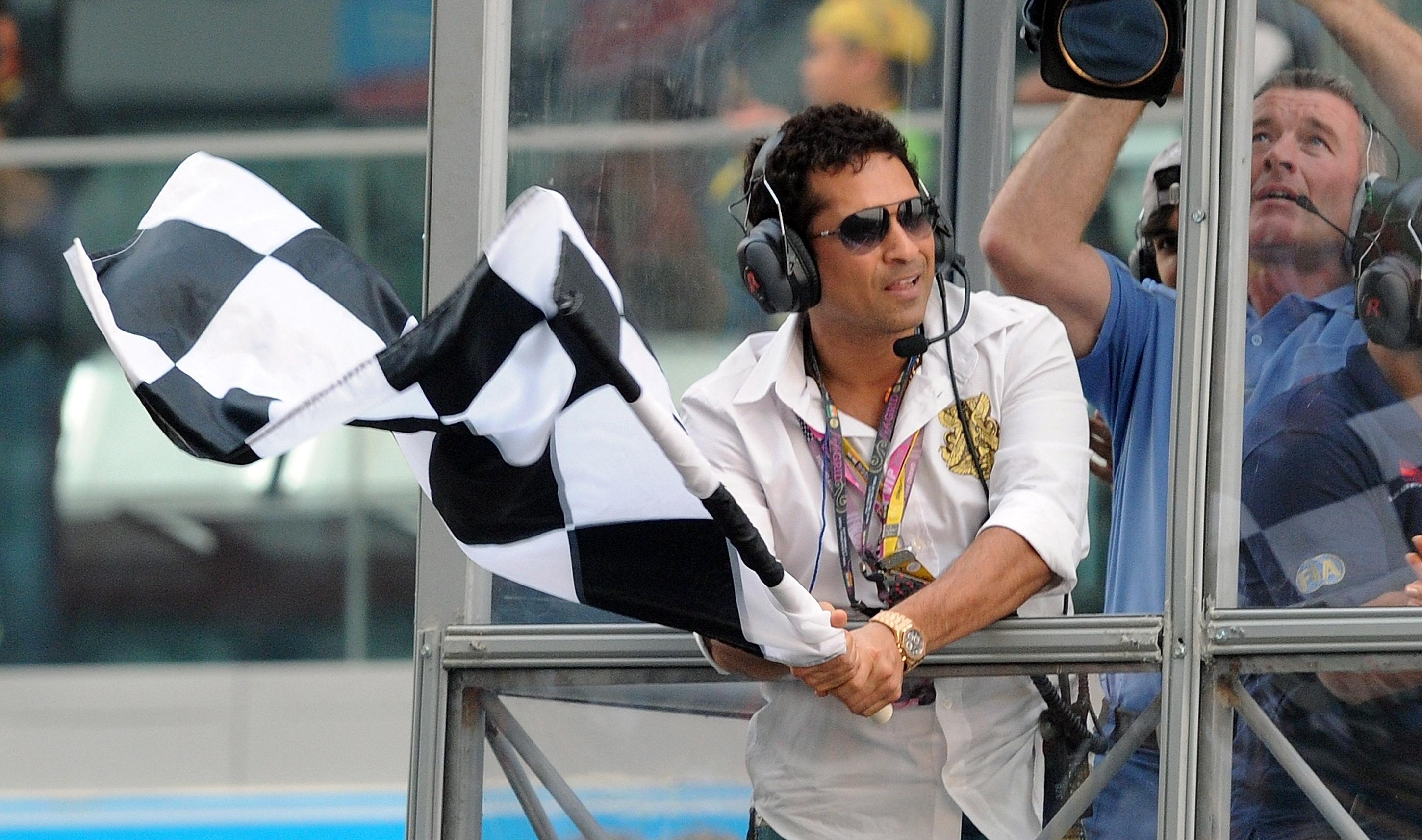 Cricket legendSachin Tendulkar waved the chequered flag at the end of the inaugural Indian Grand Prix in 2011