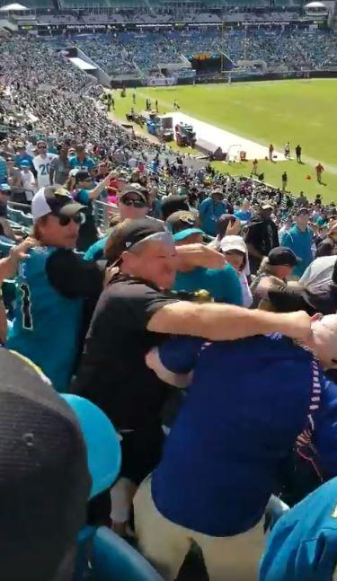 A fan knocked a fellow supporter out with a single punch at an NFL game yesterday