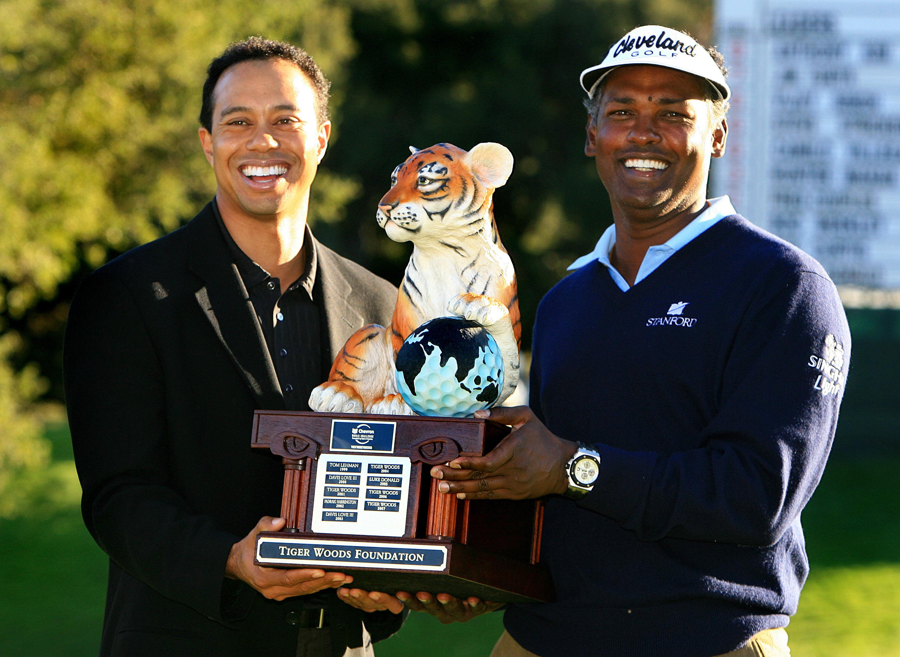 Tiger Woods hosts the Hero World Challenge where winners, like Vijay Singh here, get a tiger trophy, obviously