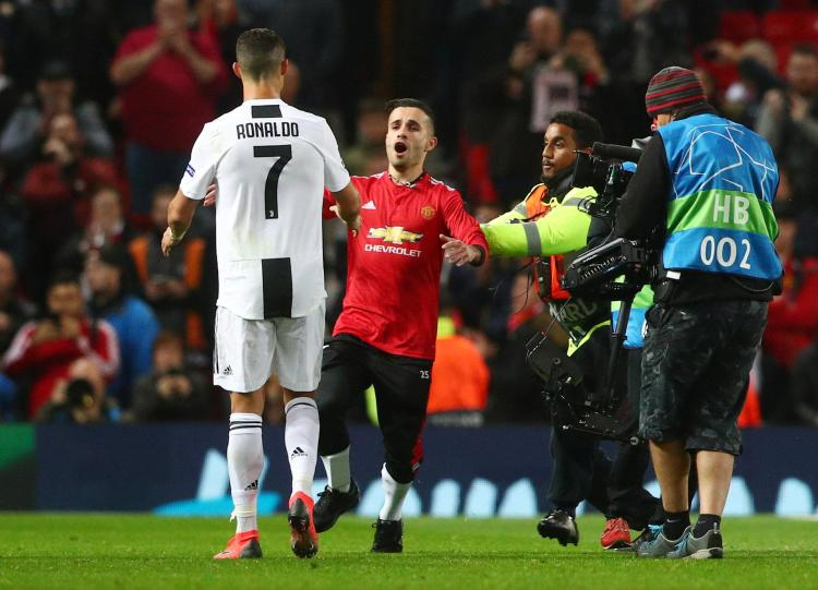 b1ca55dd7d4 The supporter attempted to greet Cristiano Ronaldo as he left the Old  Trafford pitch after Juventus