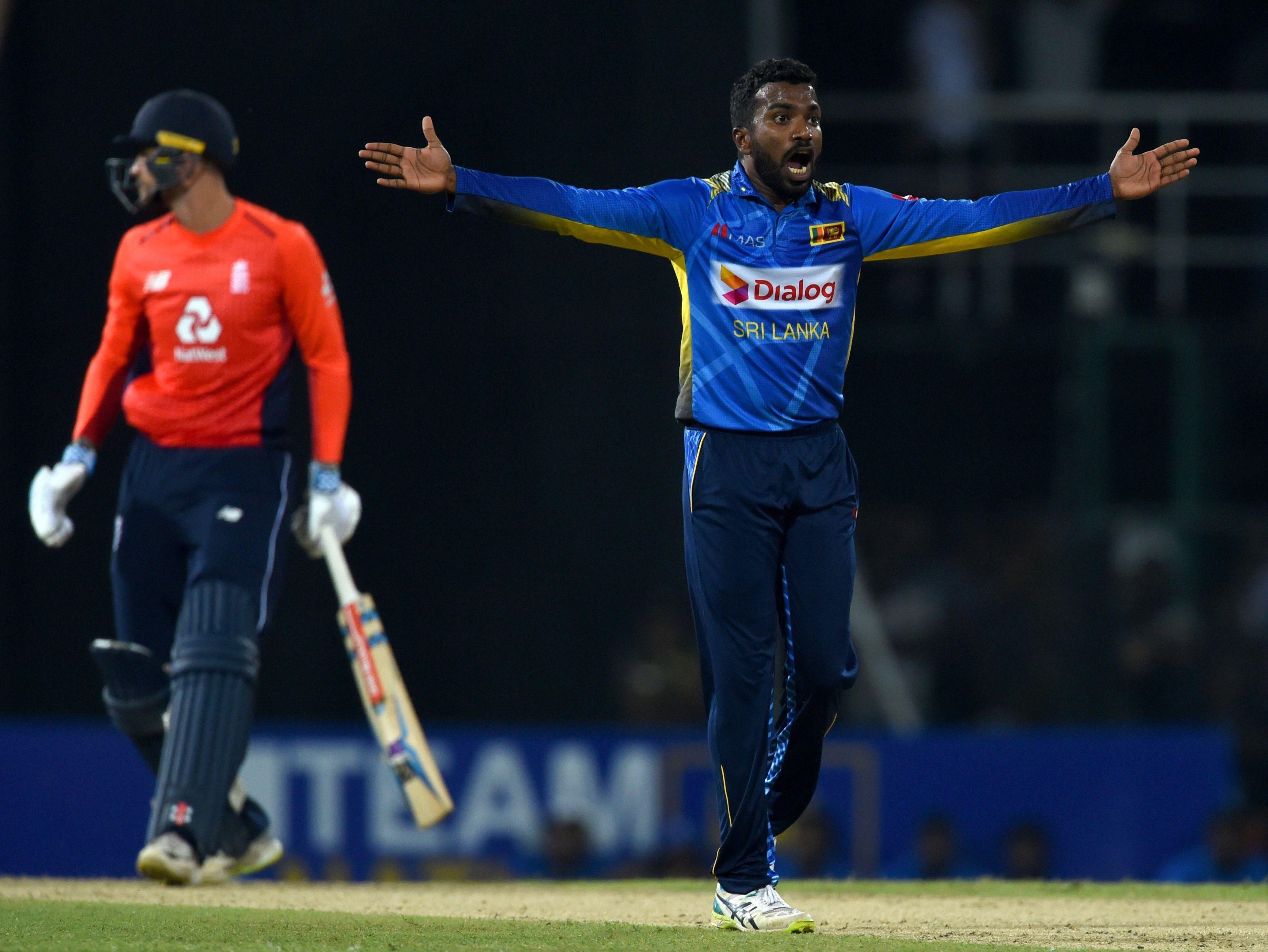 Sri Lanka's Amila Aponso celebrates after he dismissed Alex Hales at the R.Peremadasa Stadium