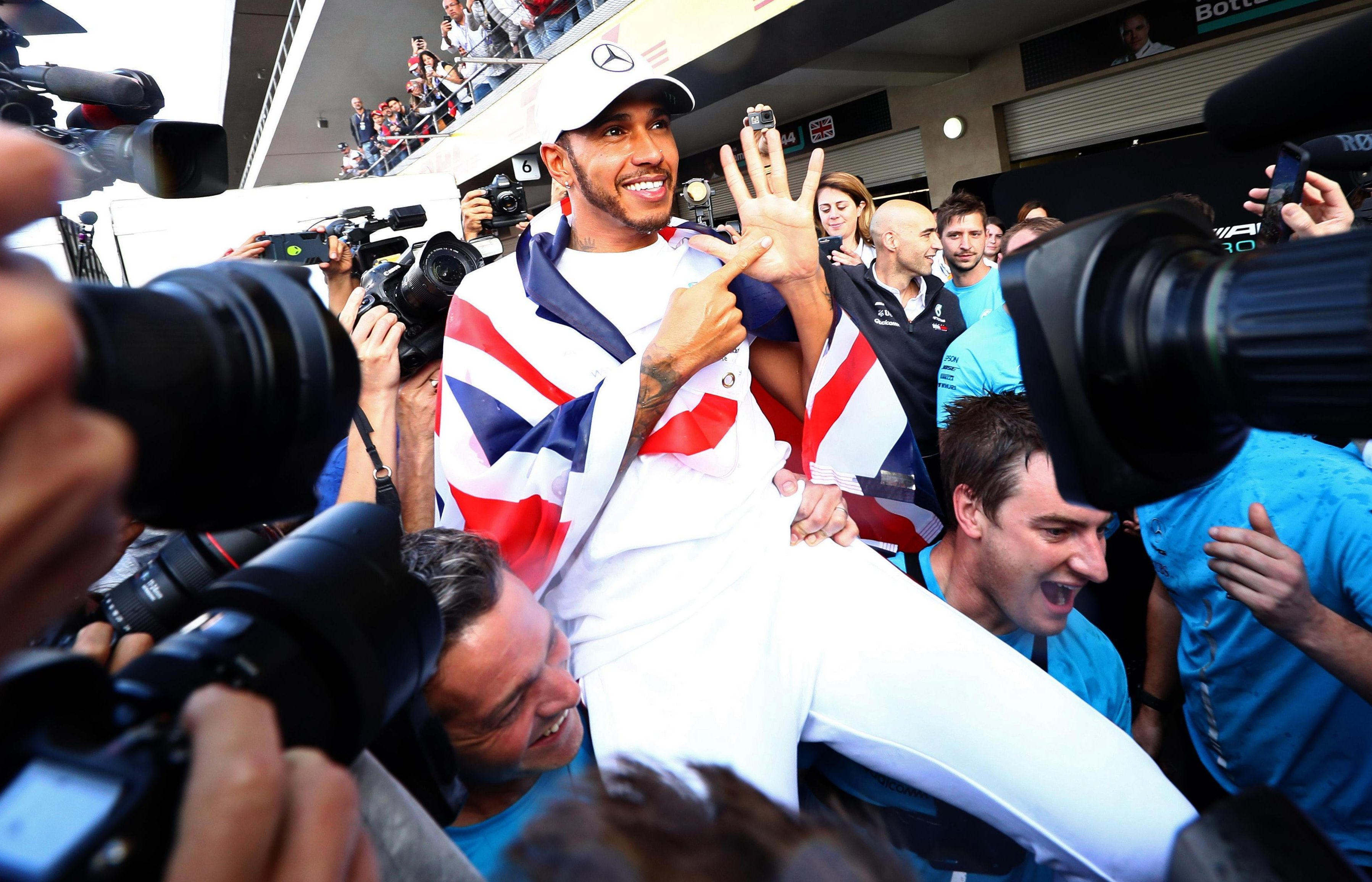 Lewis Hamilton won his fifth world title in Mexico, equalling Juan Manuel Fangio's record