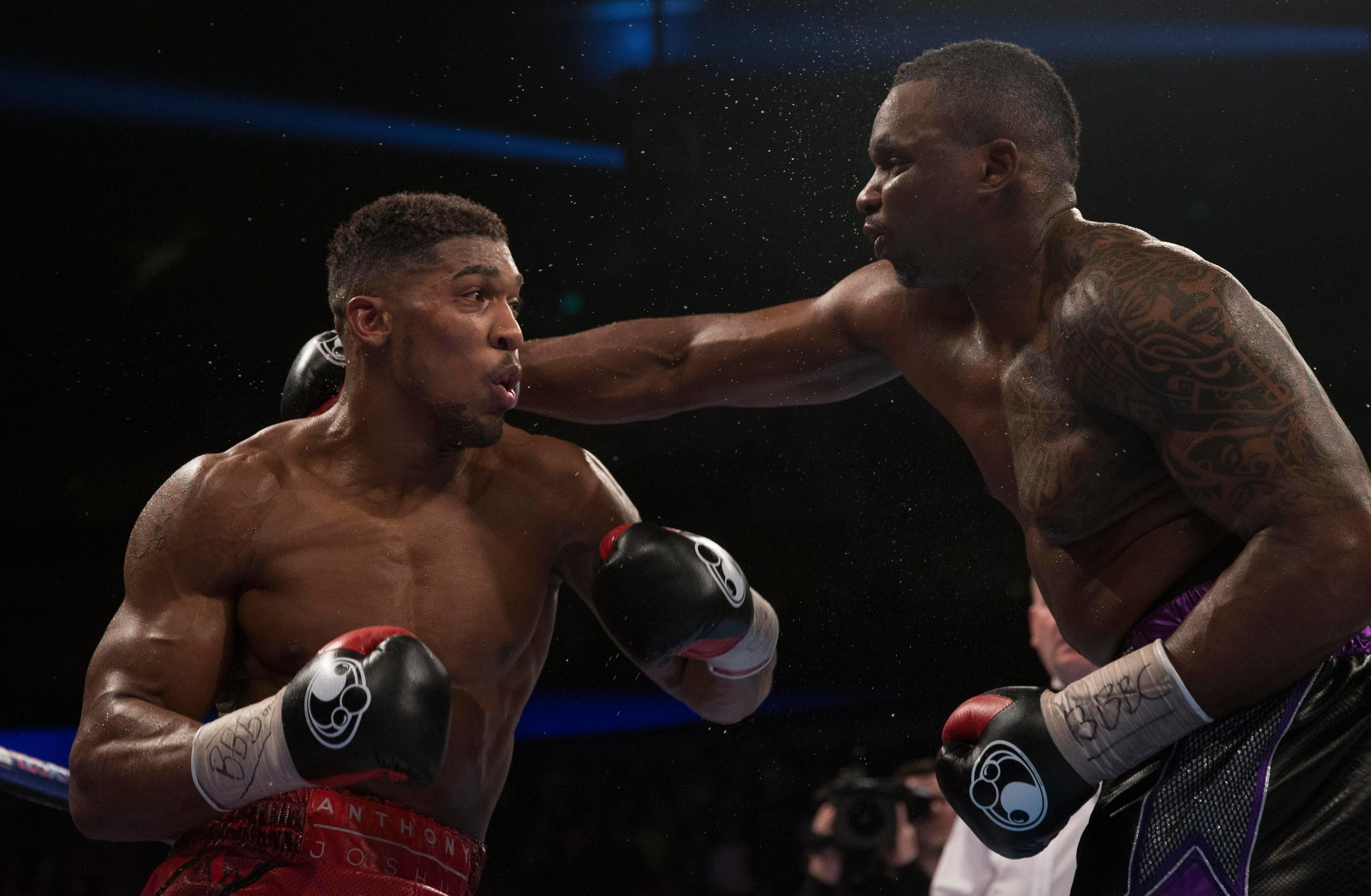 Anthony Joshua has warned Deontay Wilder he will happily fight Dillian Whyte