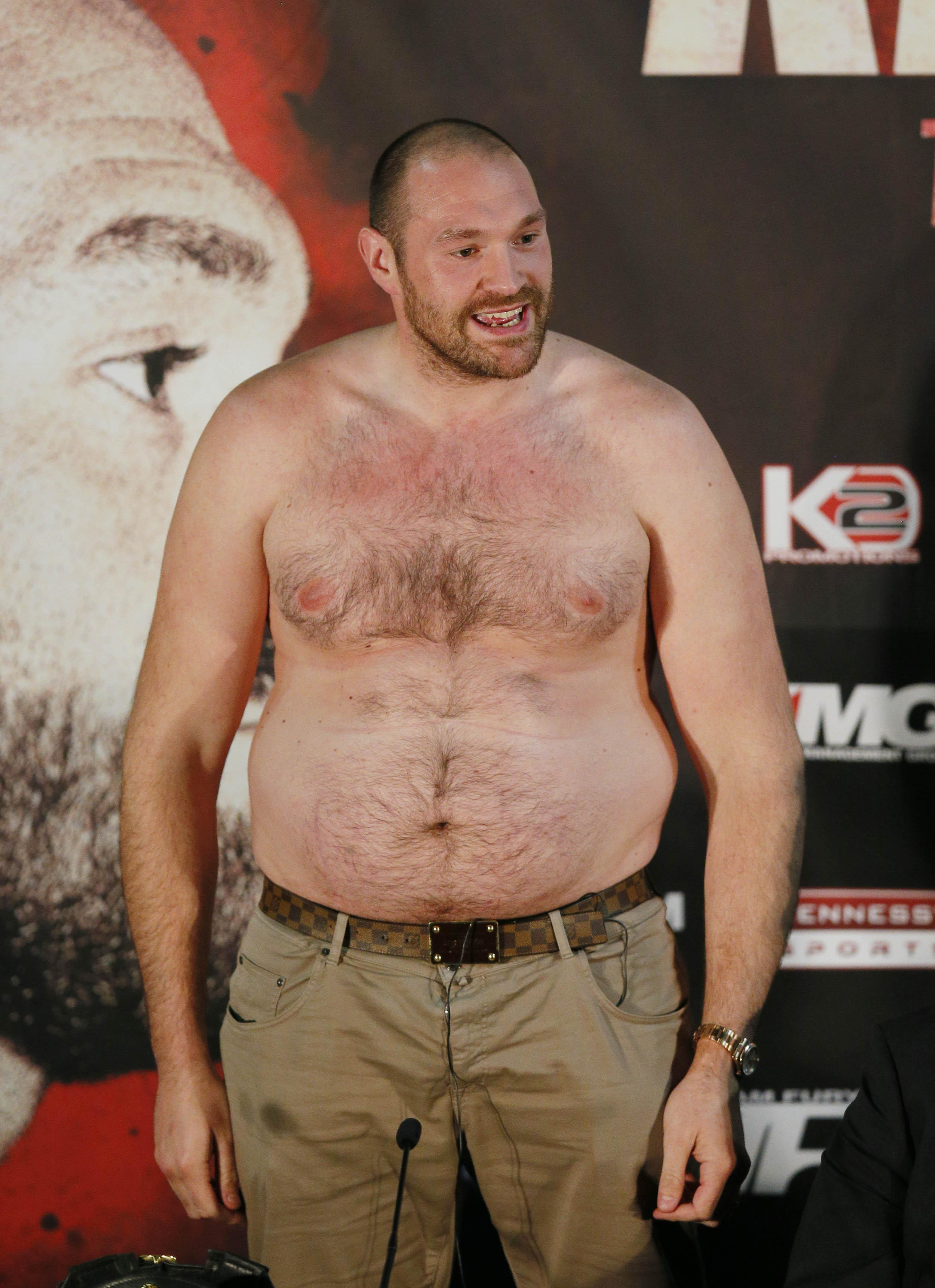 Fury ballooned to 28st after gorging on lager and pizza
