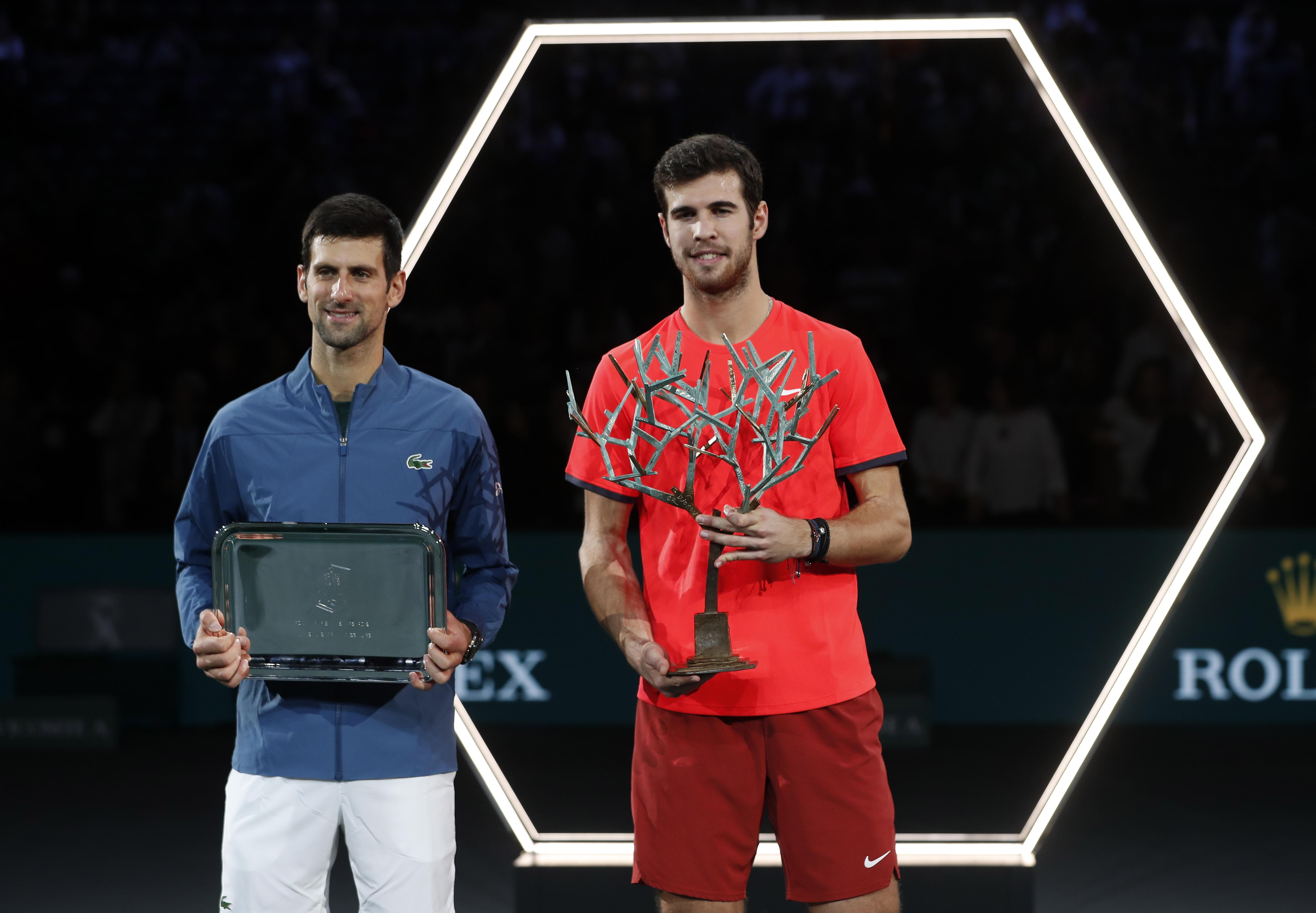 Djokovic was ill coming into the match and Karen Khachanov, right, took full advantage