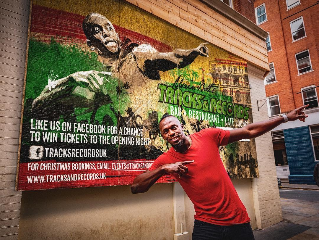 Bolt in his famous pose outside the restaurant ahead of the London opening