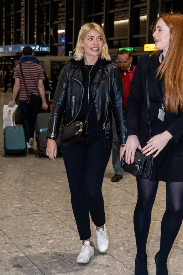 She was dressed in black as she prepared for her long haul flight