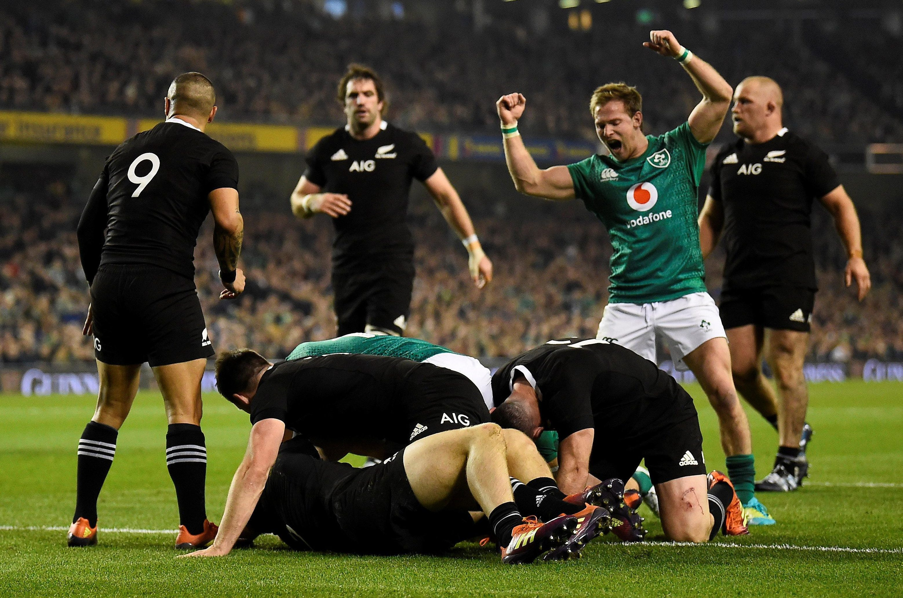 Ireland's Kieran Marmion shows the intensity of the home side in theri absorbing clash with the All Blacks