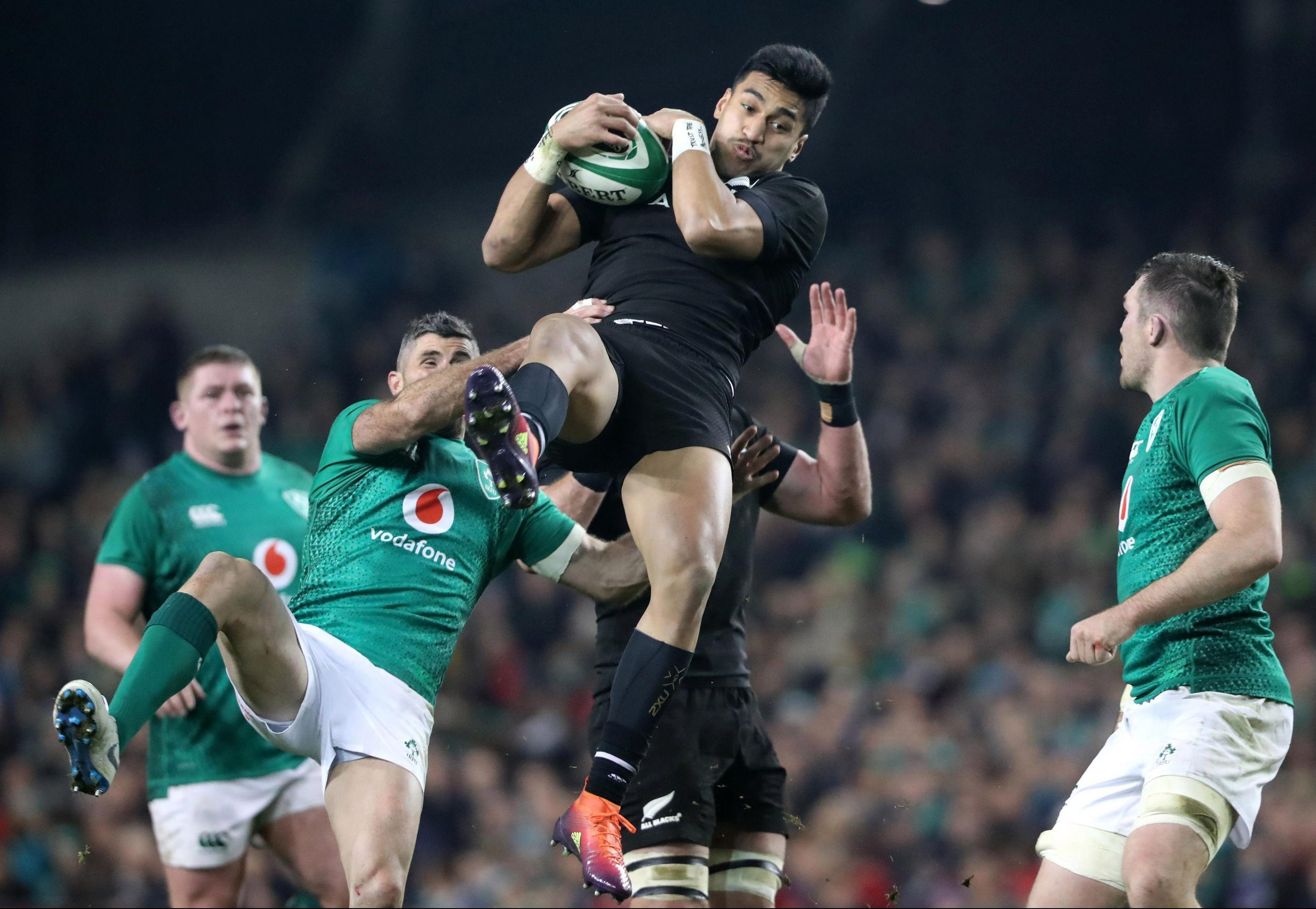 New Zealand's Rieko Ioane is pulled down by Rob Kearney during a gripping win for the Irish