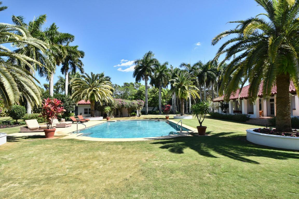 The stunning grounds include a swimming pool and two guest houses