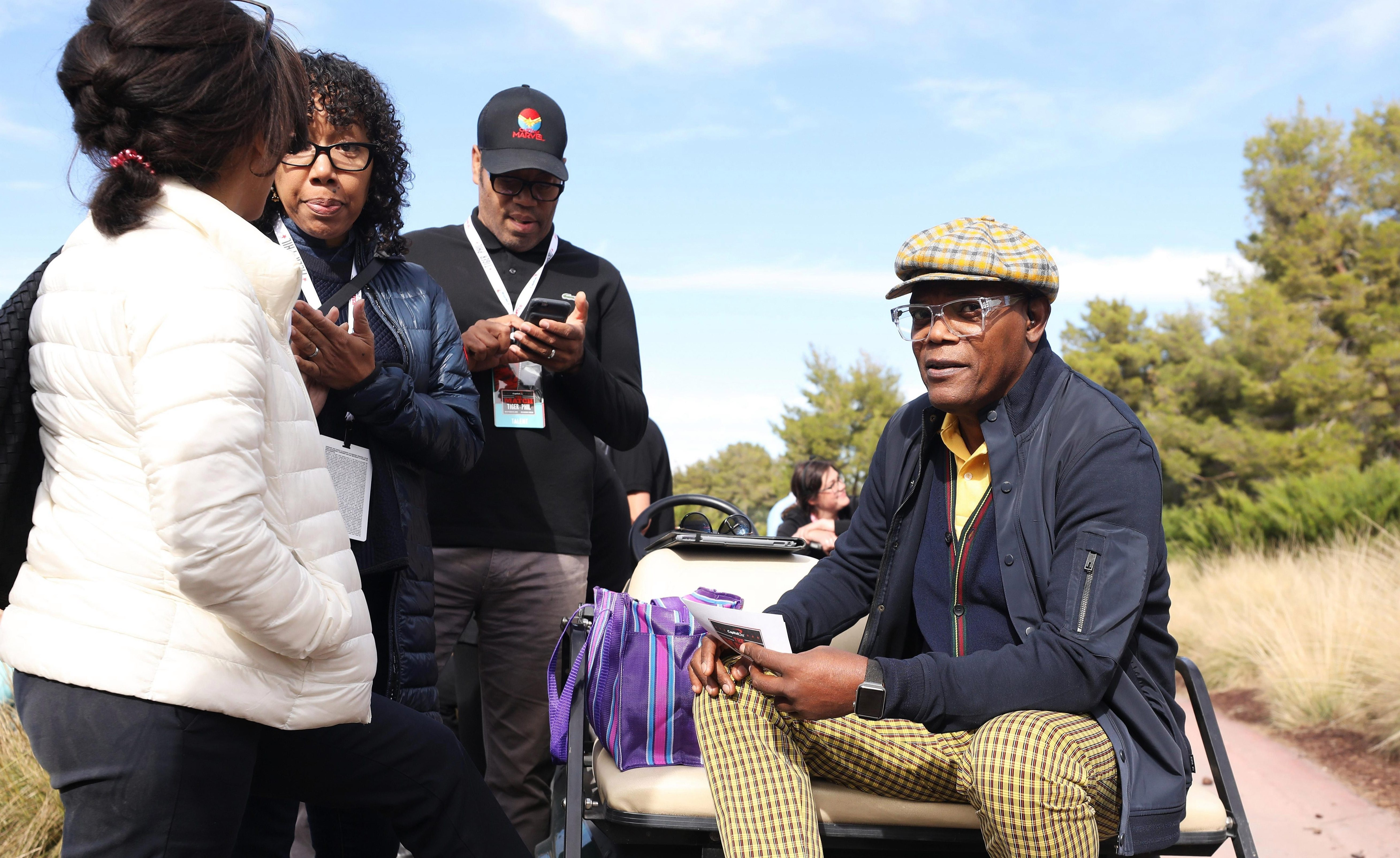 On the first hole, actor Samuel L Jackson introduces the players. Of course he does