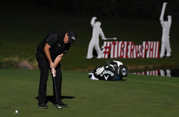 Phil Mickelson holes a four foot putt to win £7m on the 22nd hole