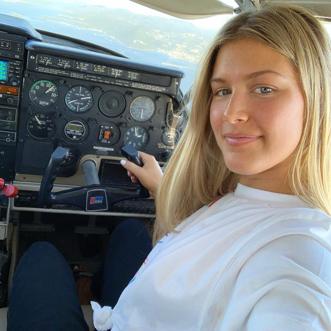 The tennis superstar posed for a selfie as she flew the sea plane