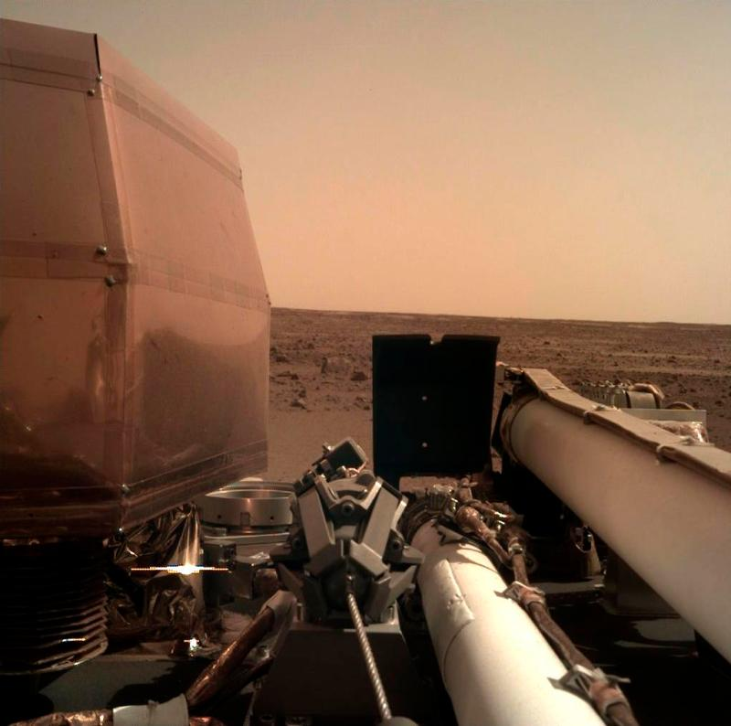 This Nasa photo shows an image on Mars that its spacecraft took using its robotic arm-mounted Instrument Deployment Camera after it landed on the planet yesterday