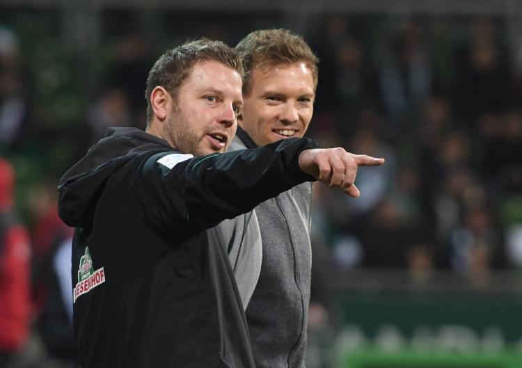 Werder Bremen coach Florian Kohfedlt in discussion with Julian Nagelsmann