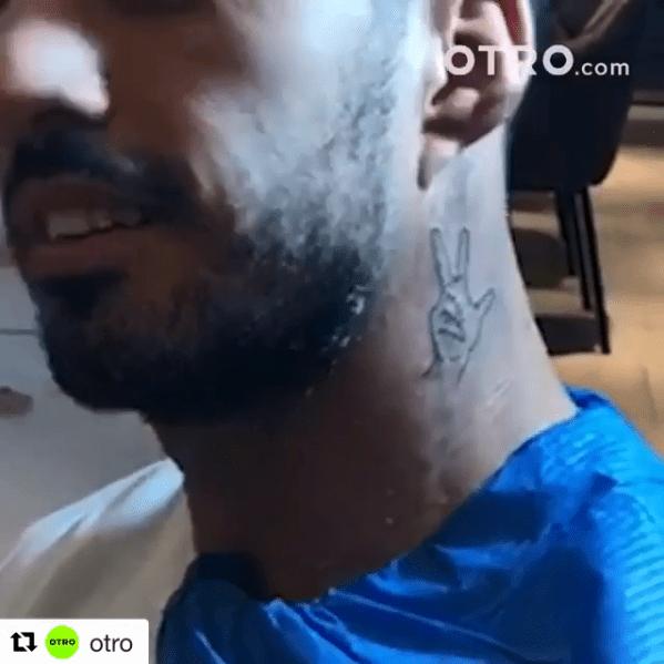 Luis Suarez has had his trademark celebration inked on his neck