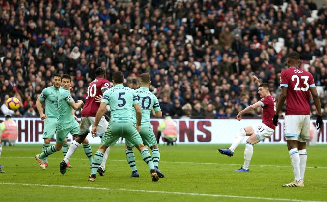 Declan Rice curls his shot into the top corner as West Ham opened the scoring against Arsenal