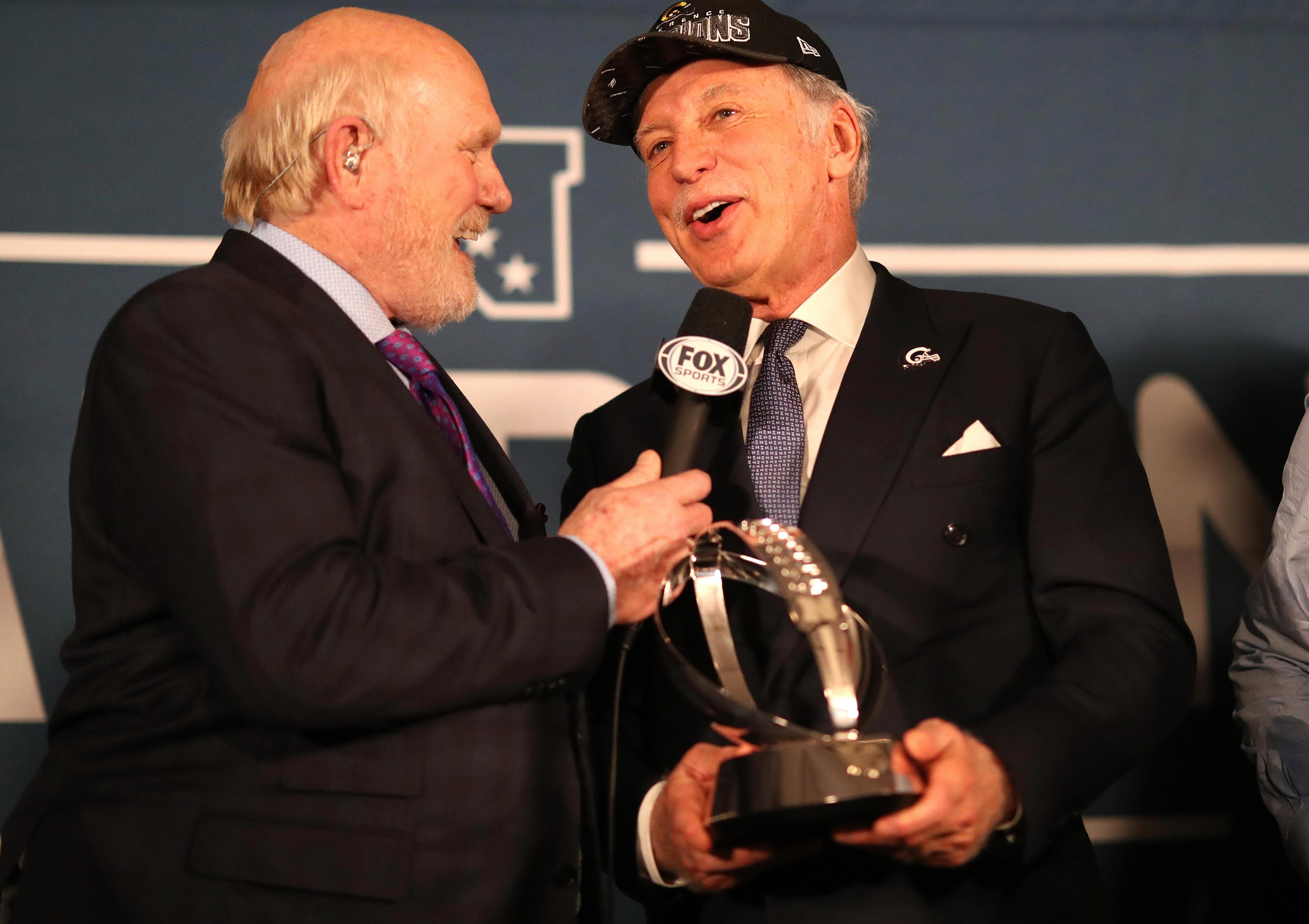 Stan Kroenke receiving the George Halas Trophy after the win over New Orleans Saints