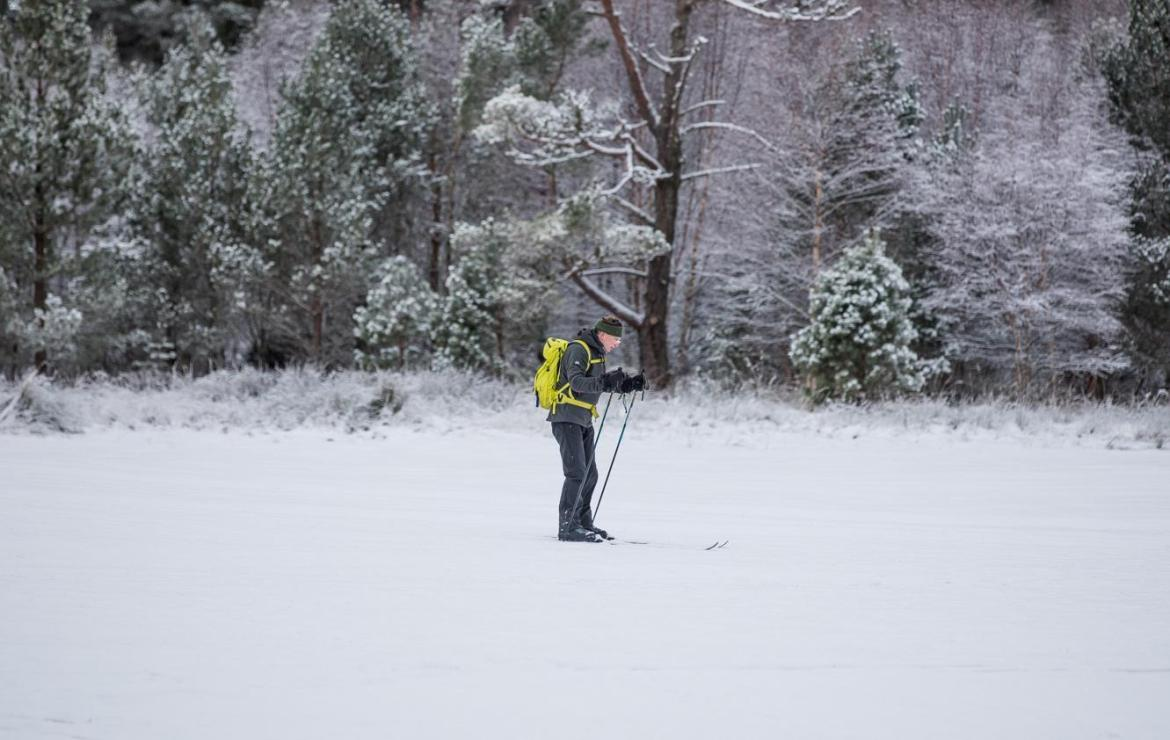 A cross-country skier in the Scottish Highlands yesterday. Even here will see warmer temperatures today - but another cold blast is on the way