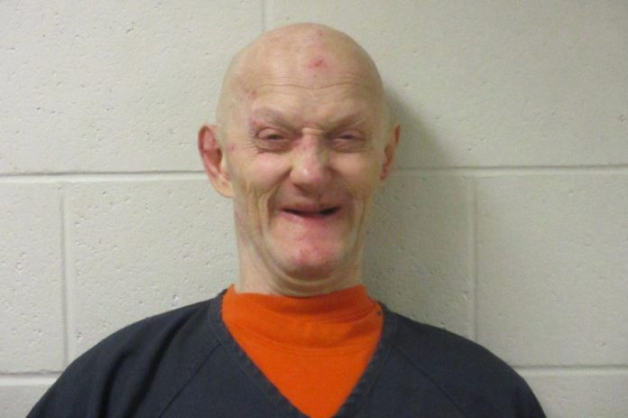 Duane Arden Johnson, 58, was seen cackling in his mugshot after he was arrested for neglect