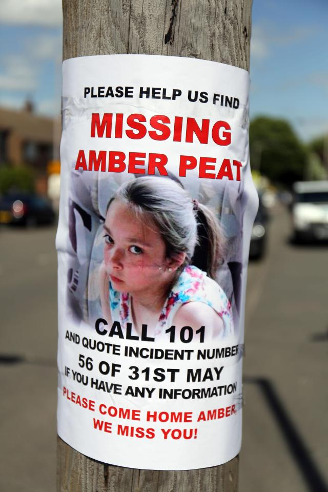 A poster attached to a pole appealing for information about the then missing teenager