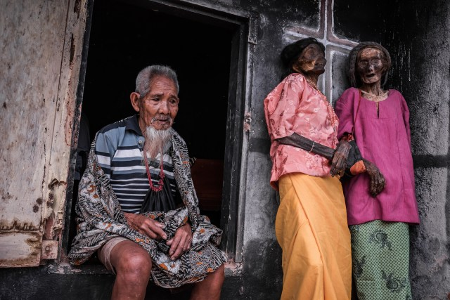 They are given new clothes and are brought to visit their old homes - here, a man sits near his late wife and her late friend