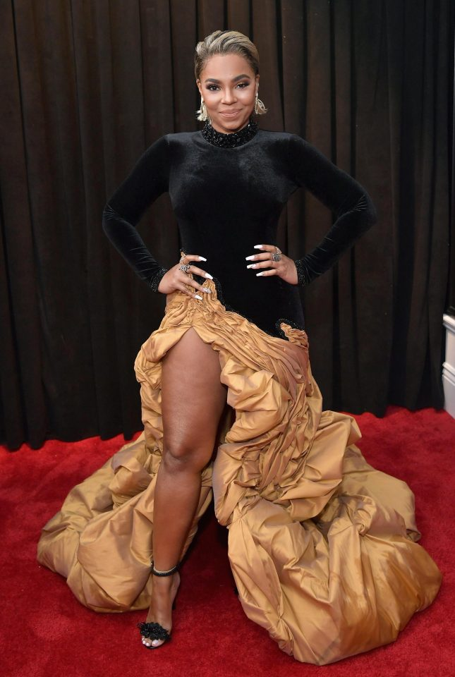 Ashanti wore a gold and black dress with bizarre ruffles